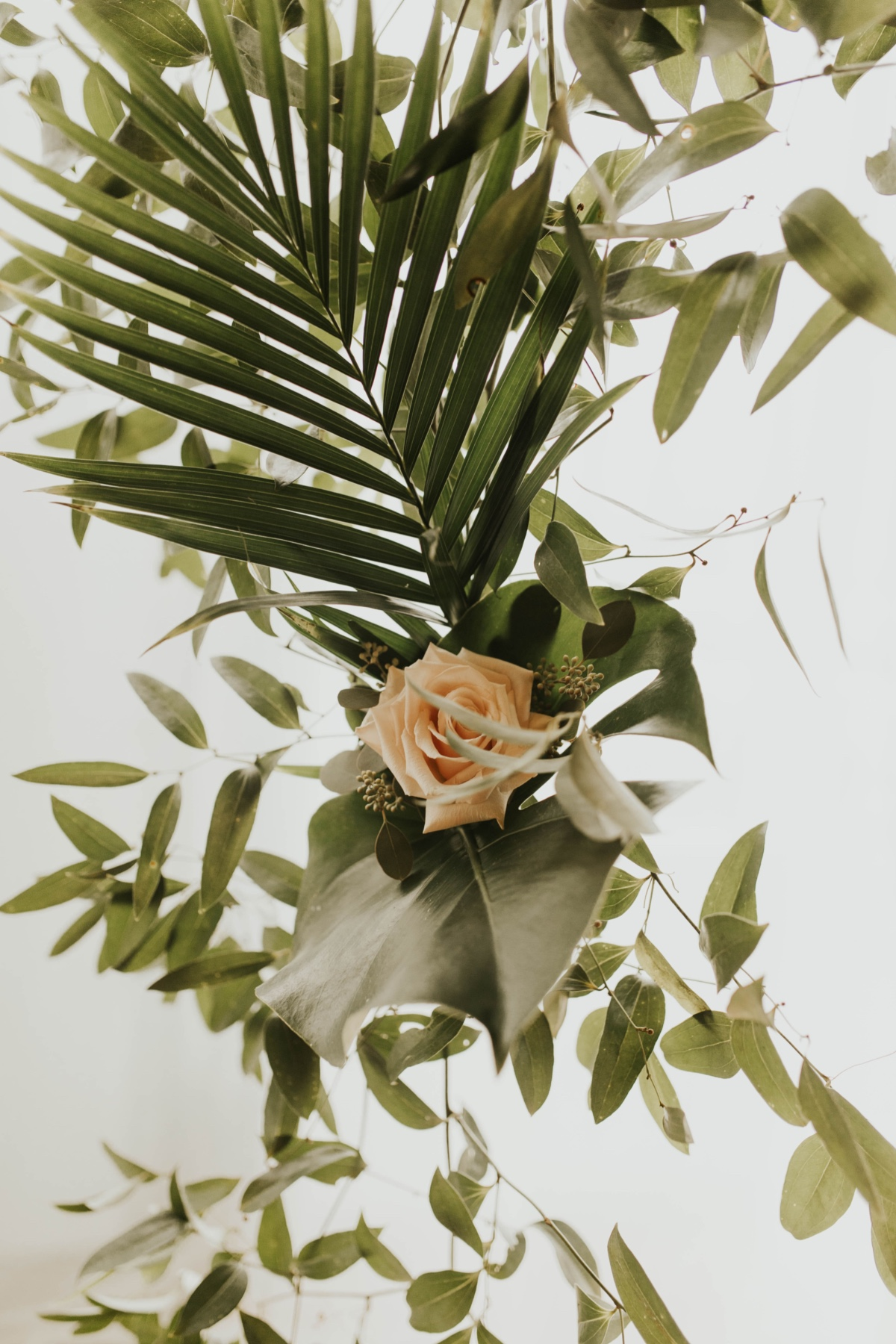 greenery mixed with palm leaves for wedding backdrop
