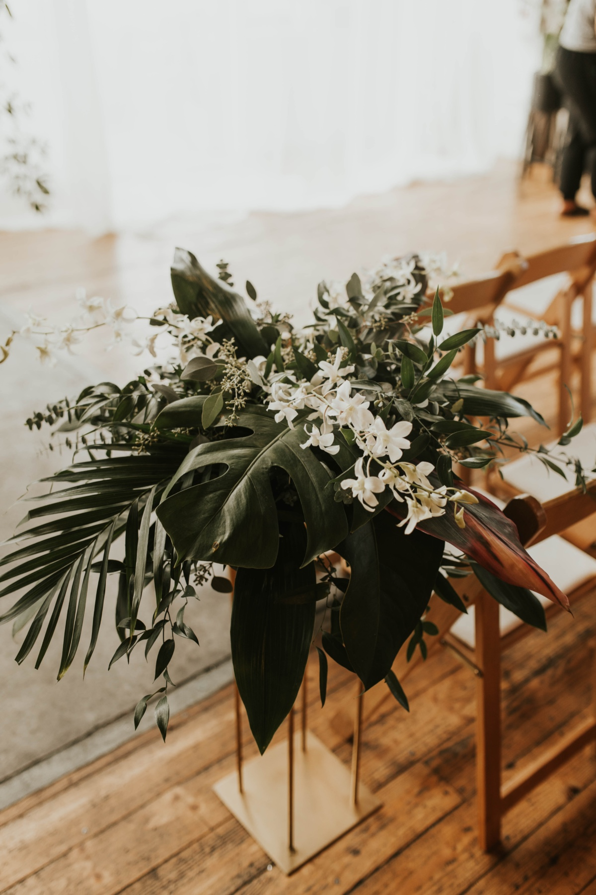 tall floral arrangements used as aisle runners