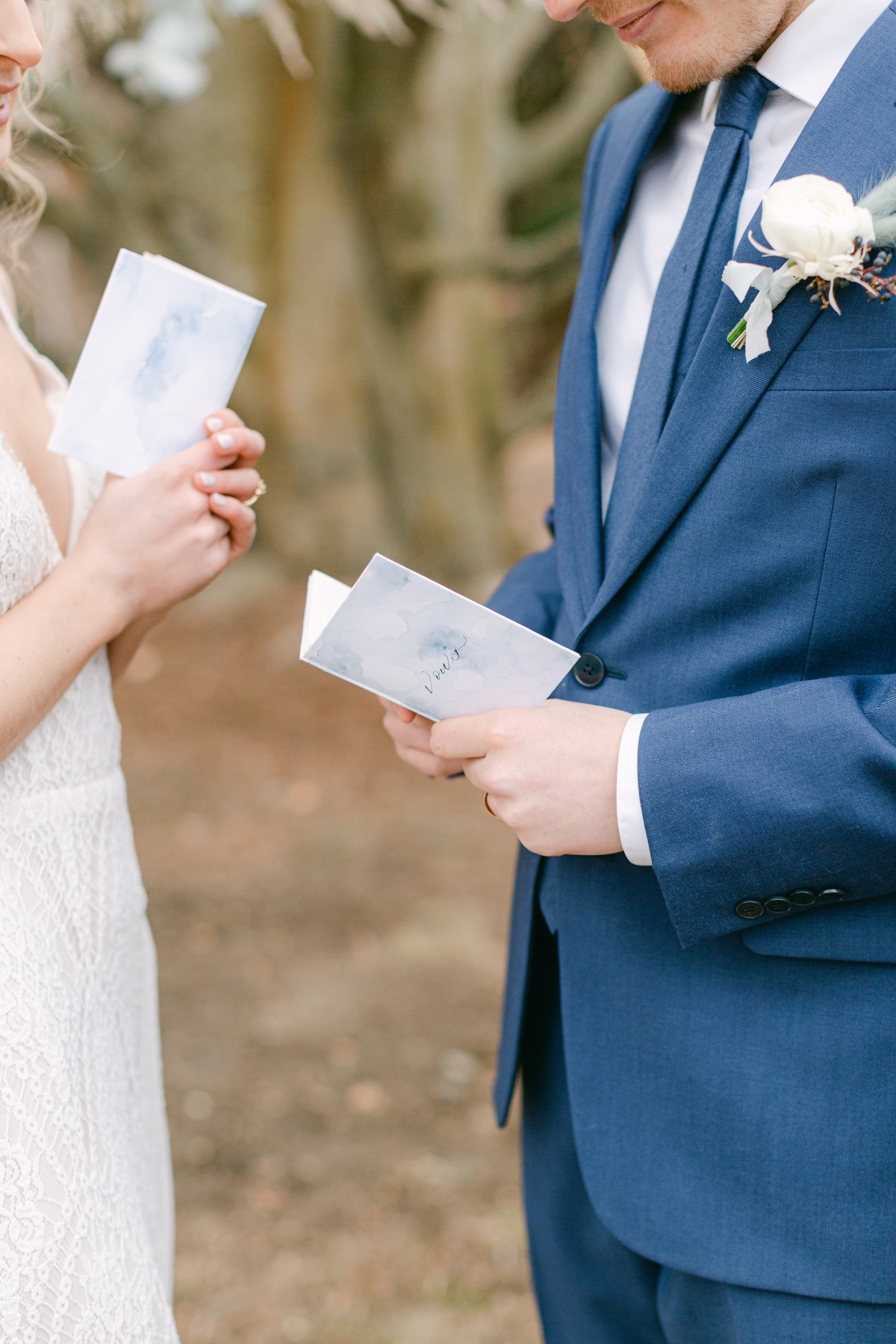 couple reading vow wedding books