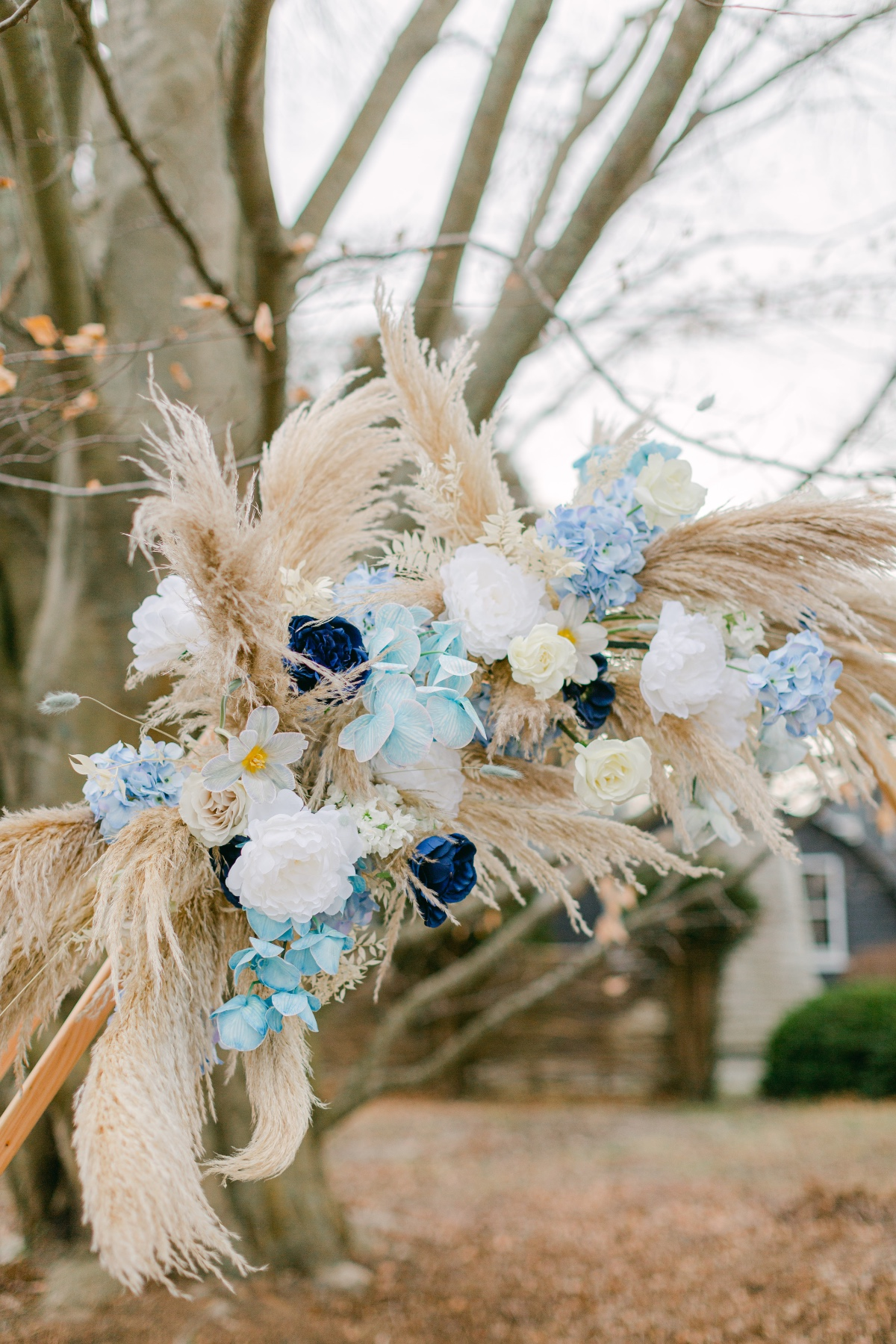 Pampas Grass and blue florals used in wedding backdrop