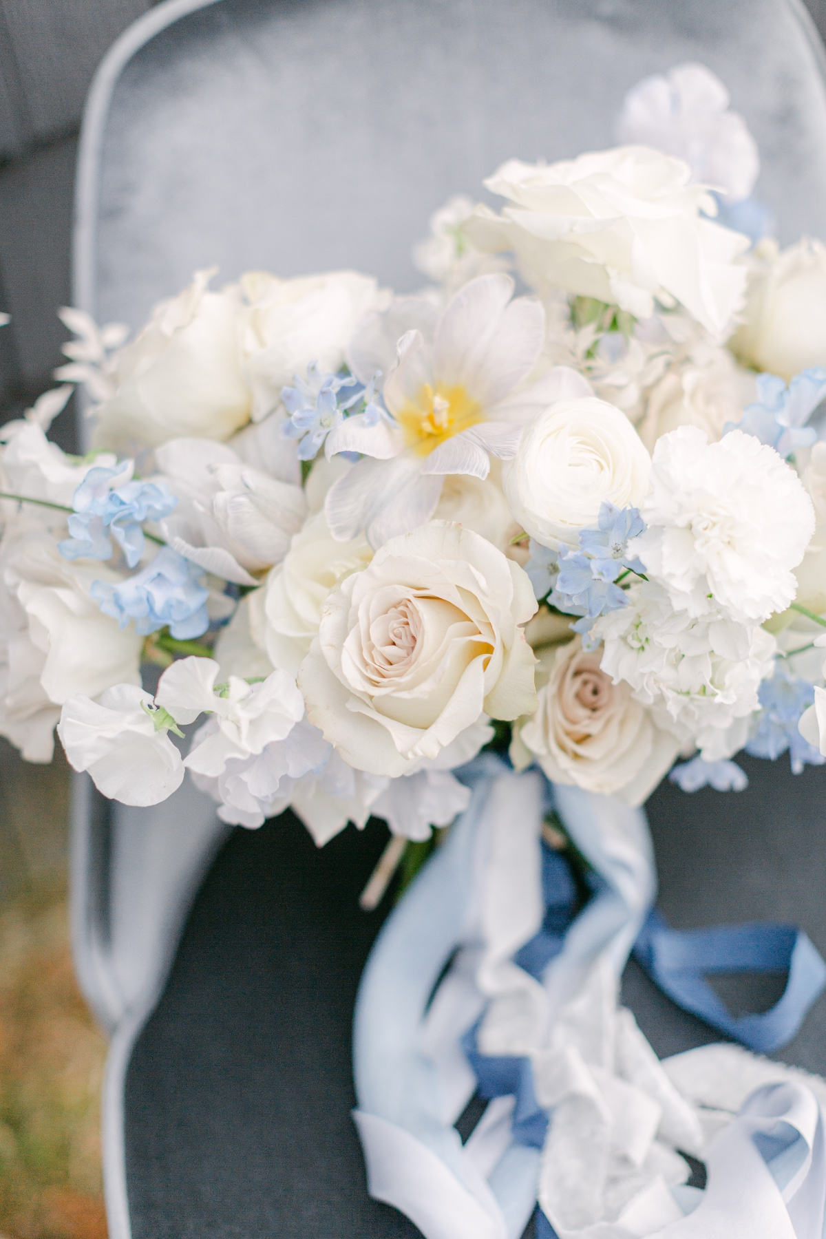 white wedding bouquet paired with silk blue ribbon