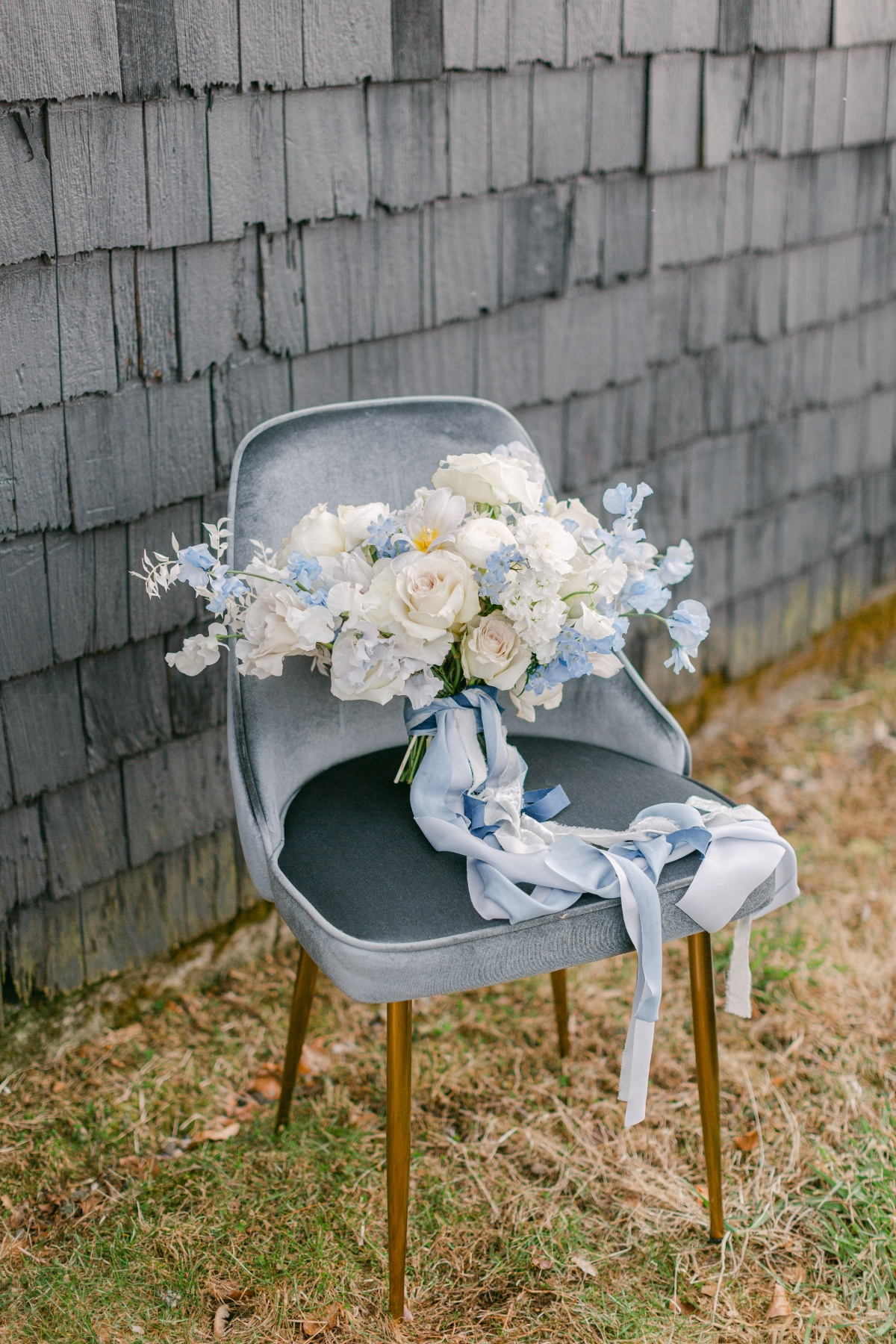 blue and white wedding bouquet on blue velvet chair