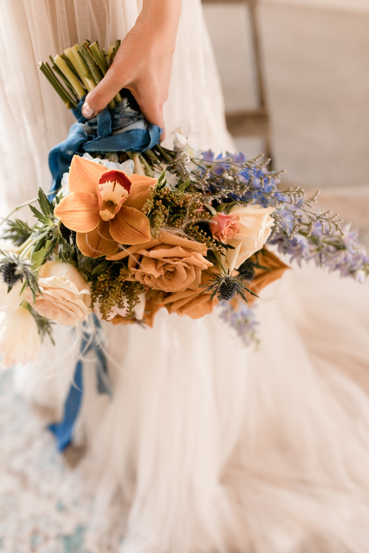 whimsical blue, orange and white wedding bouquet by Flourish & Knot