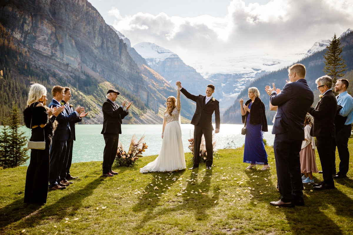Intimate wedding ceremony in front Lake Louise