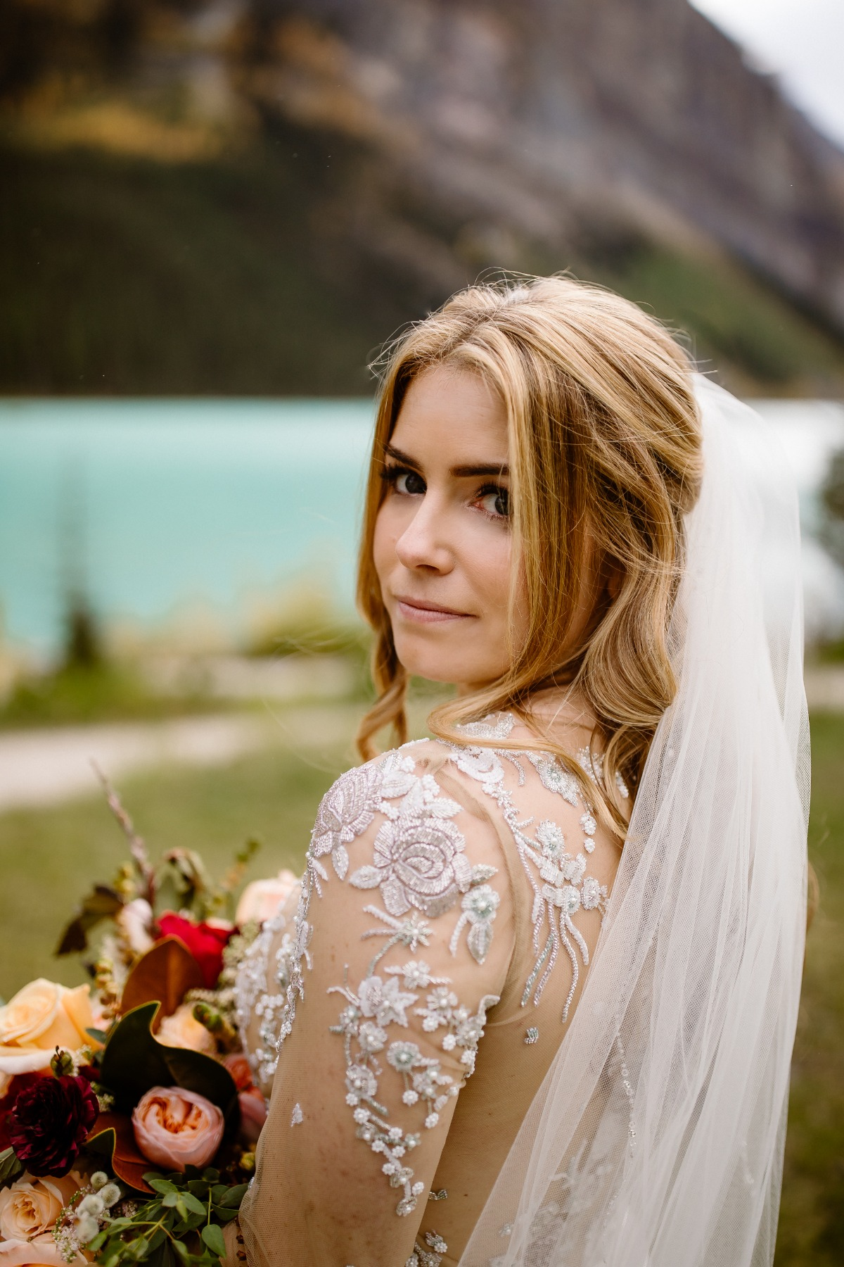 bridal portrait in front of Lake Louise in Banff National park