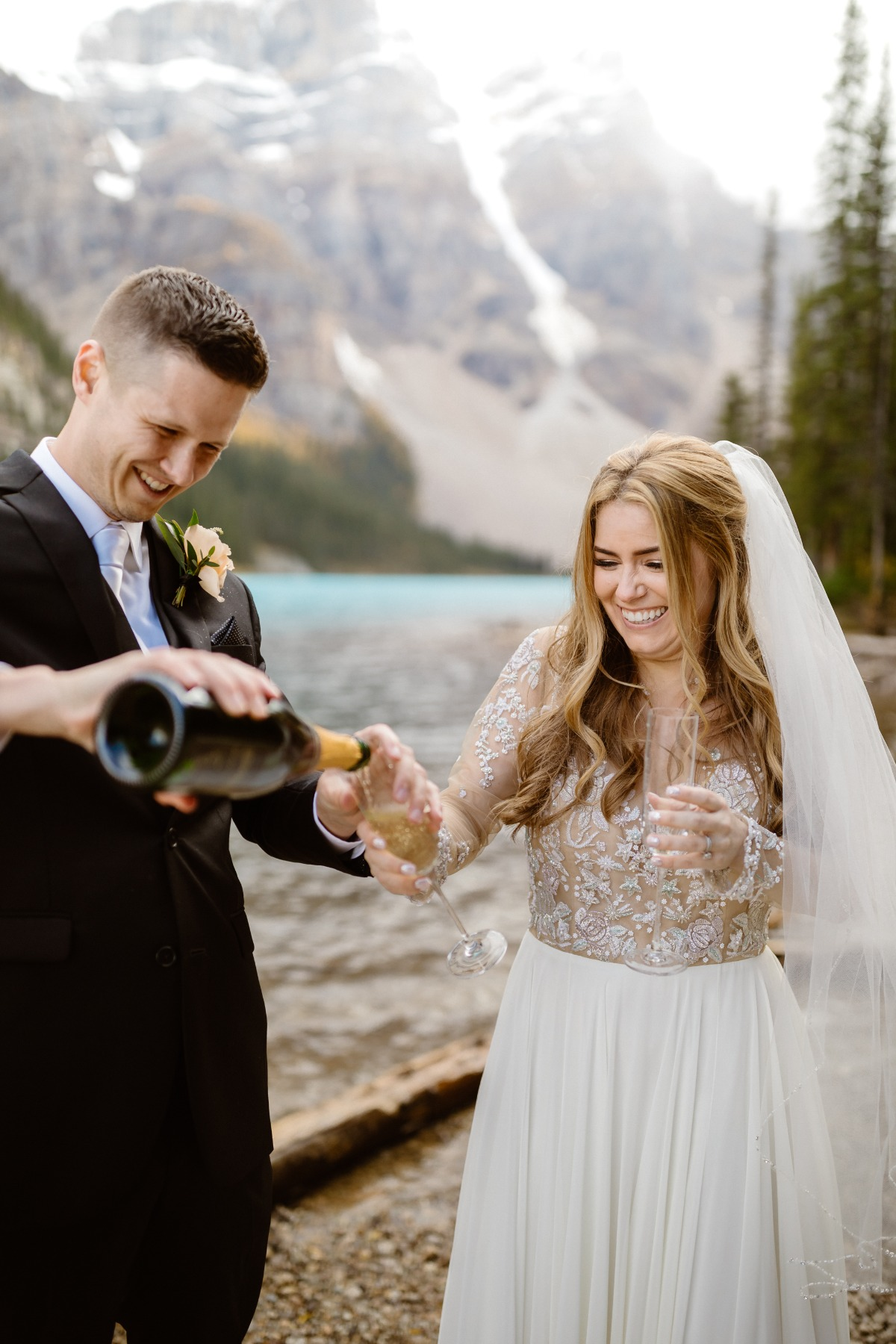 Champagne toast on shore of  Moraine Lake