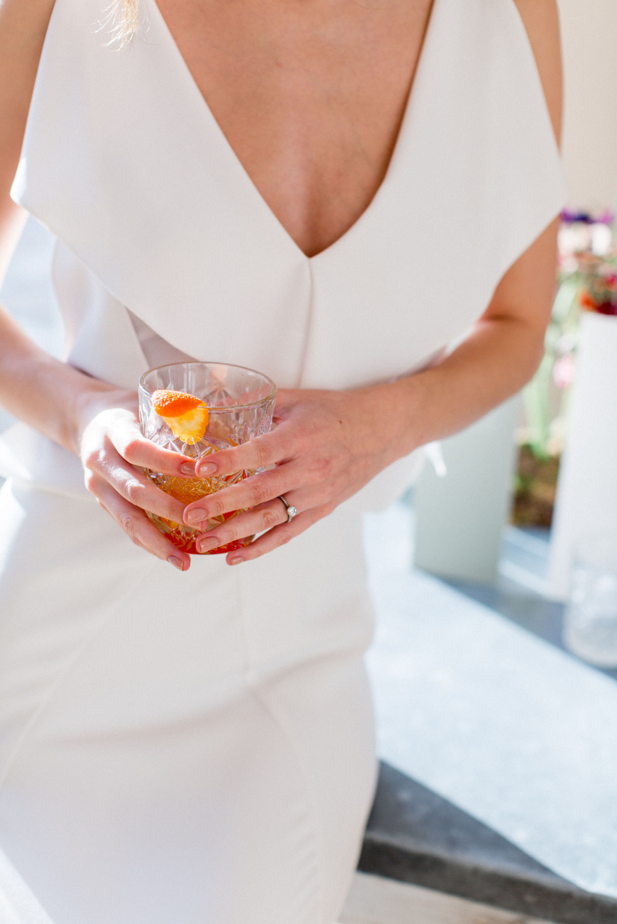 bride drinking an old fashion