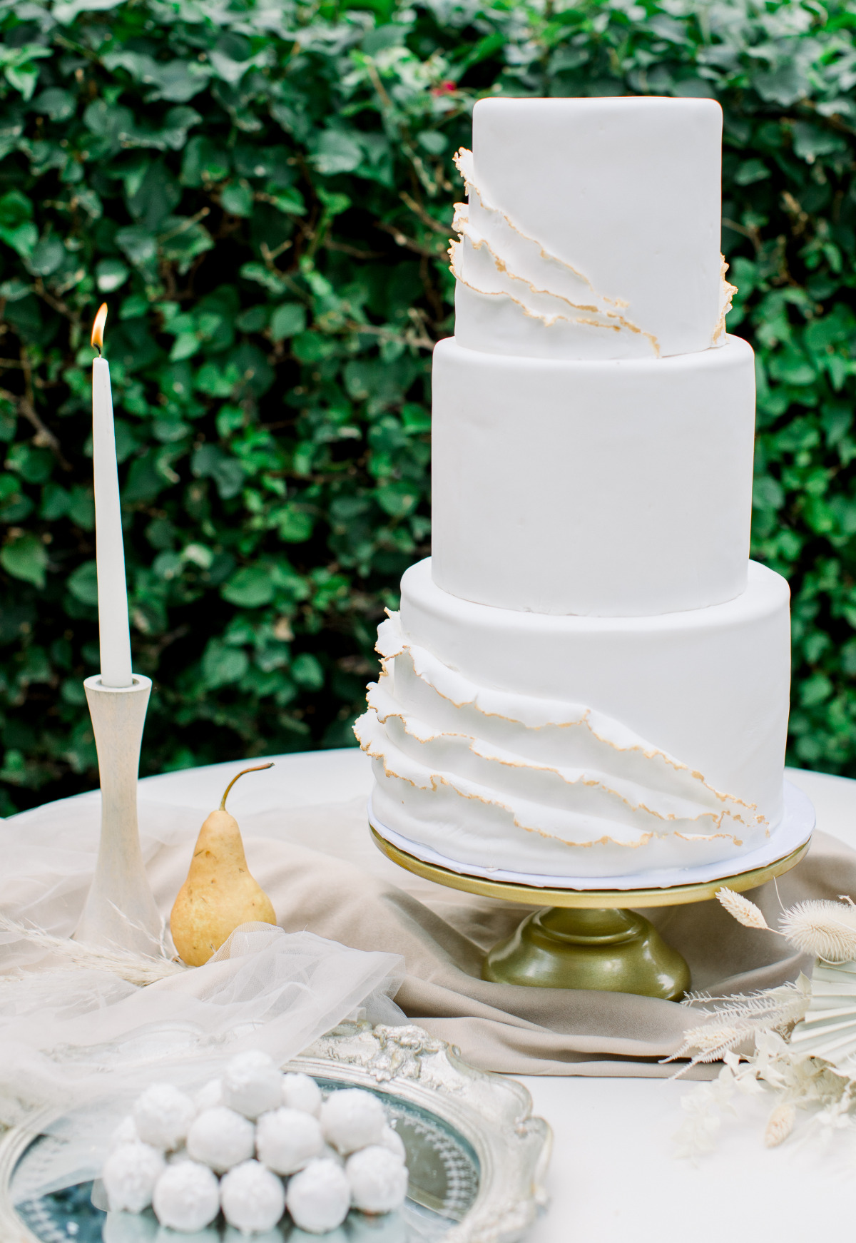 white wedding cake with burnt ruffle sides by Amour de Sucre