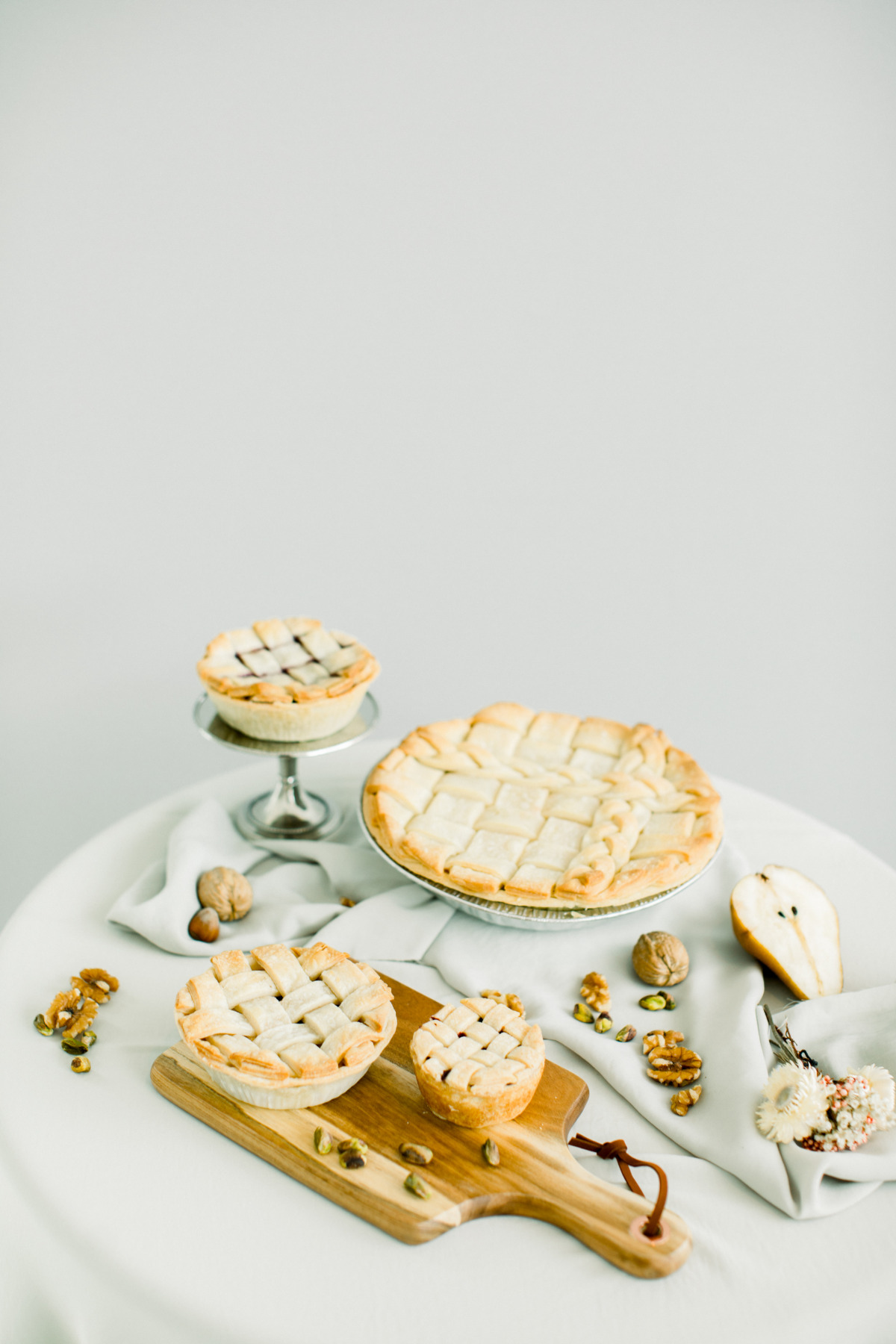white dessert table with pies