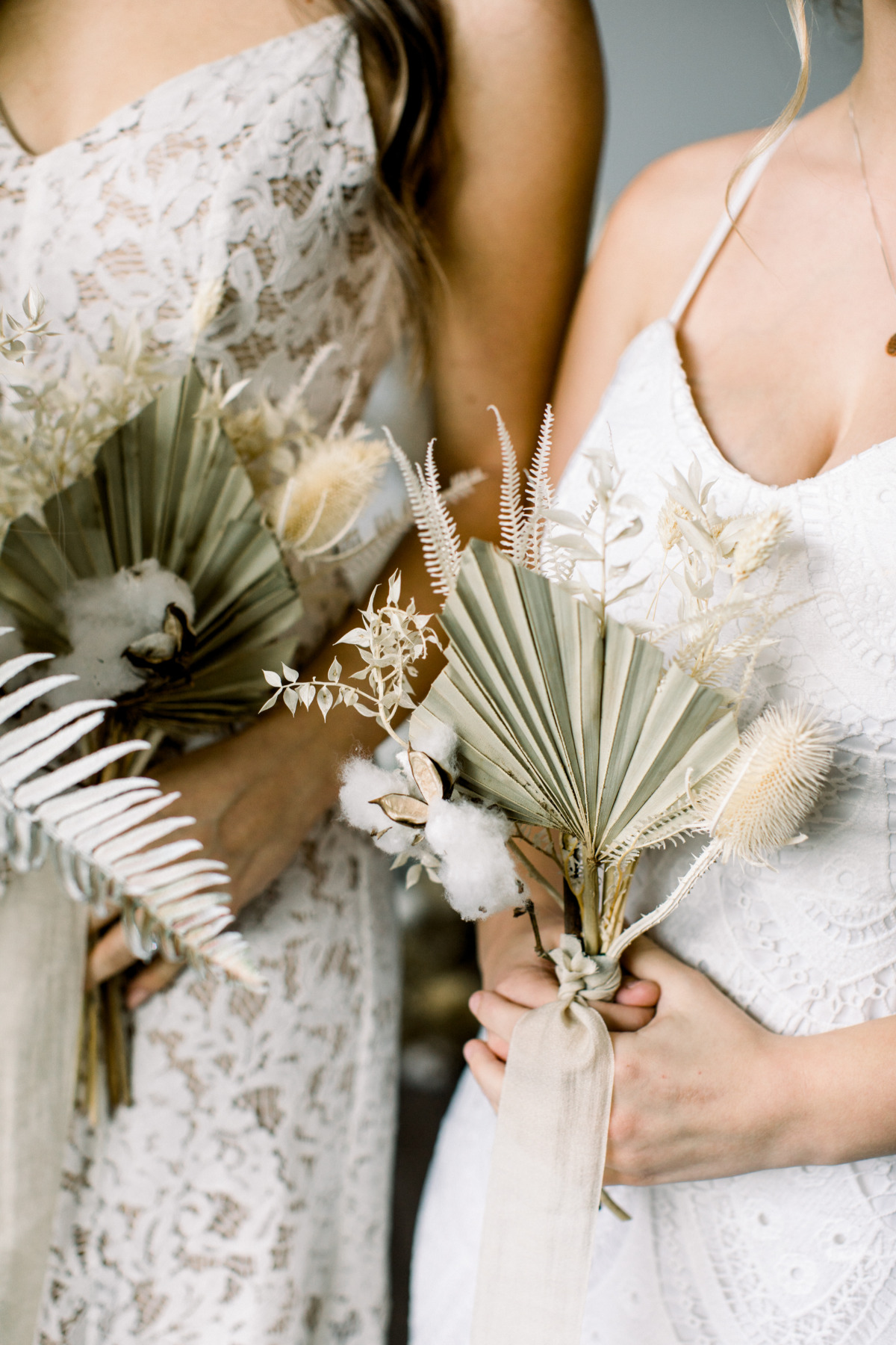 bridesmaids holding pampas grass wedding bouquets
