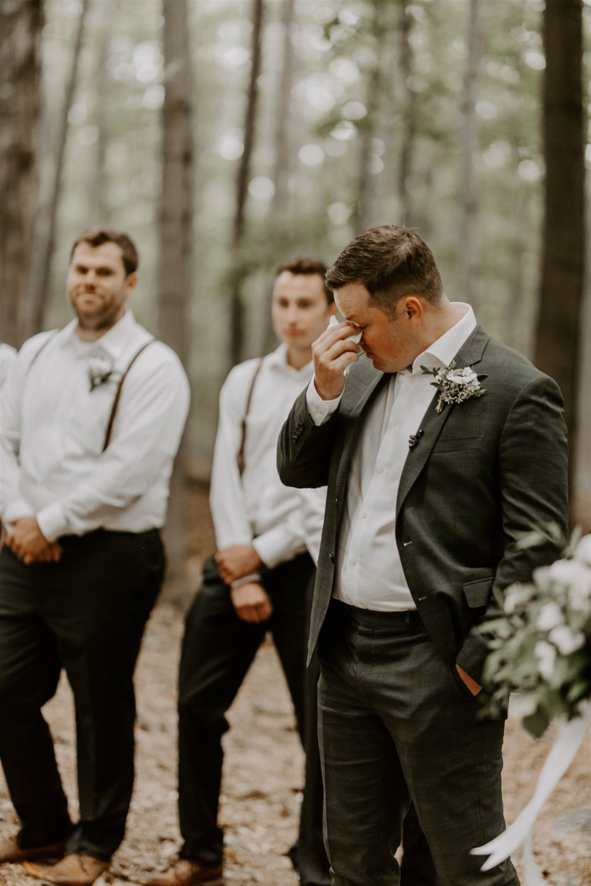 Groom crying at the alter