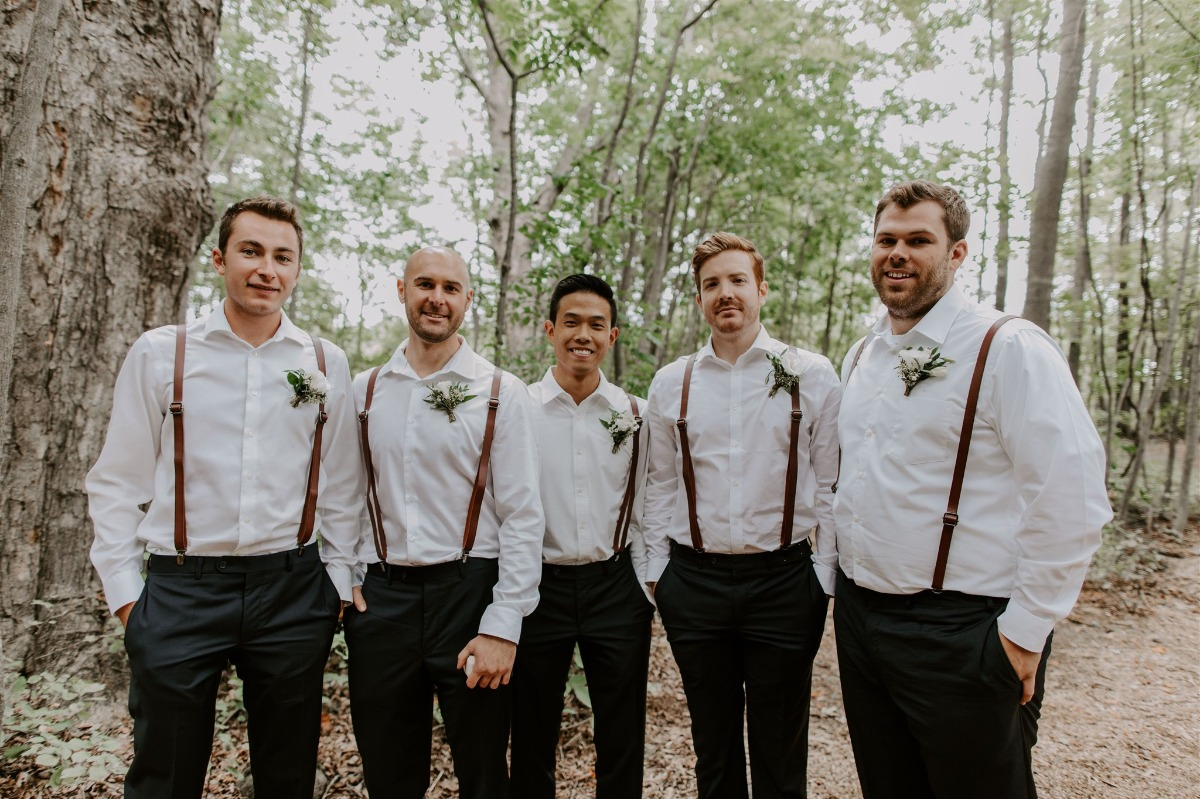 groomsmen in overalls, navy pants and brown shoes