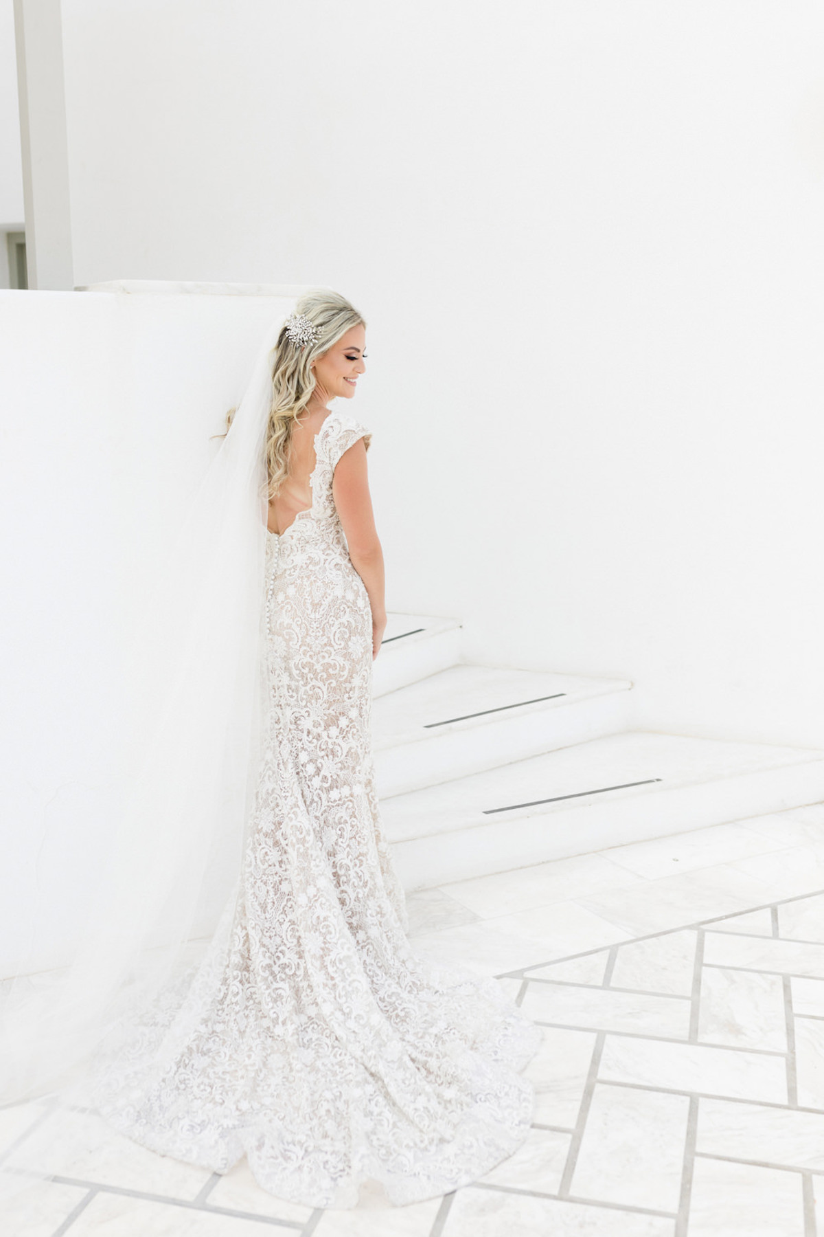 long lace wedding dress with keyhole back by Berta