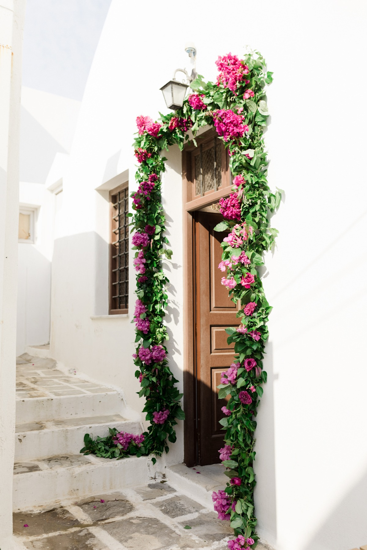 door way adorned with greener and magenta florals
