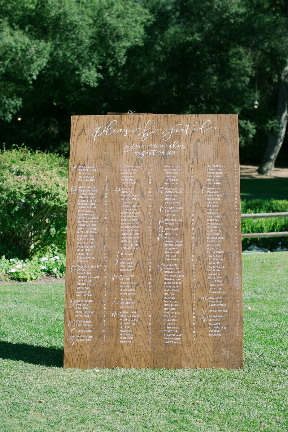 hand written wooden seating chart