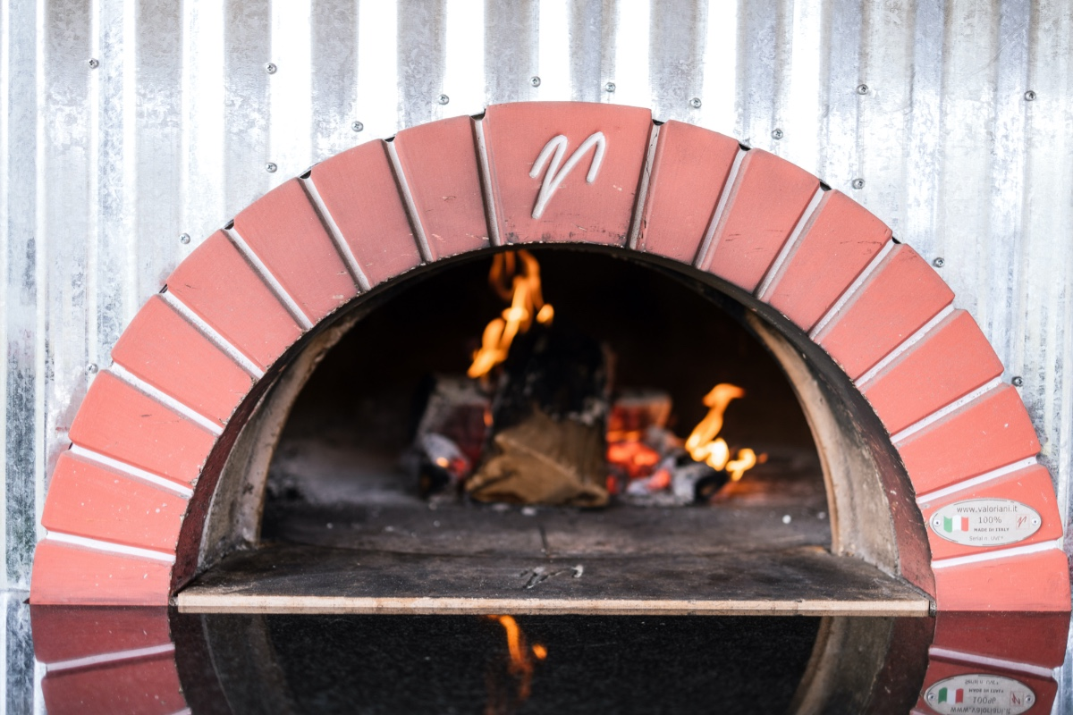 wood fire pizza oven at wedding