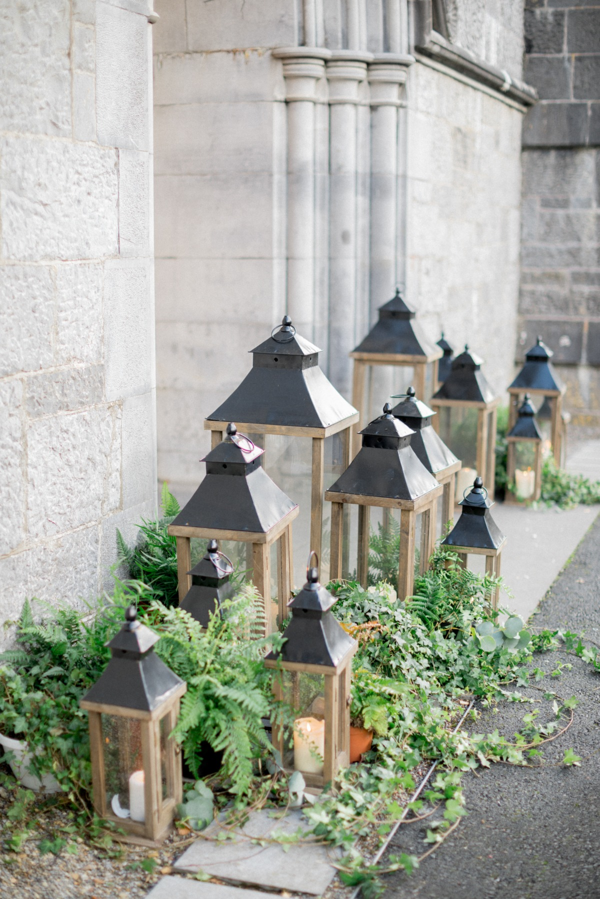 Church decorated with ivy and lanterns for wedding ceremony