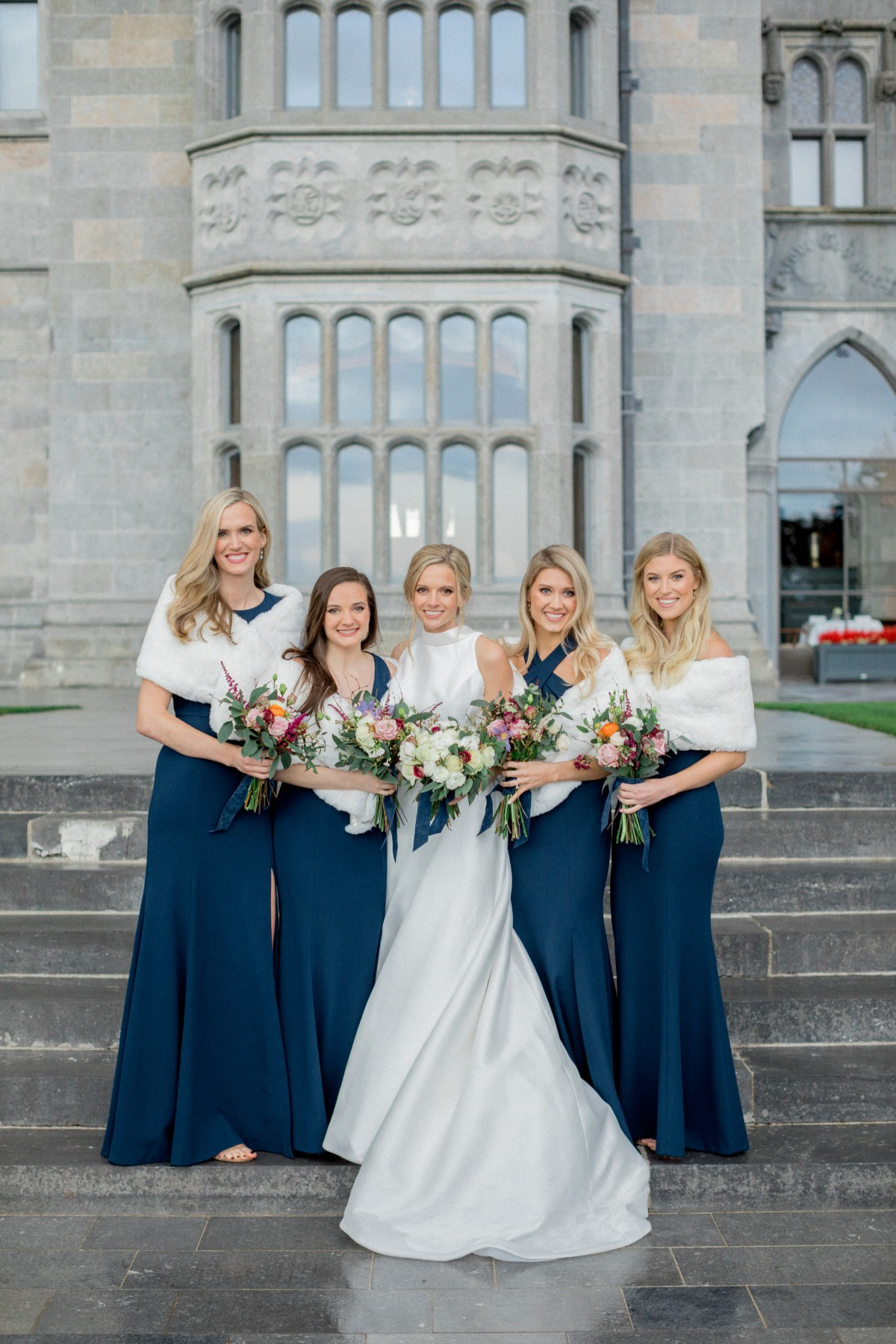 Navy Blue Bridesmaid dresses from Jenny Yoo paired with white fur stoles