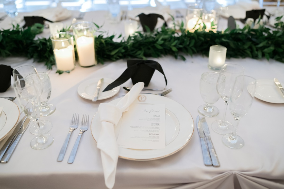 black and white table decor with greenery