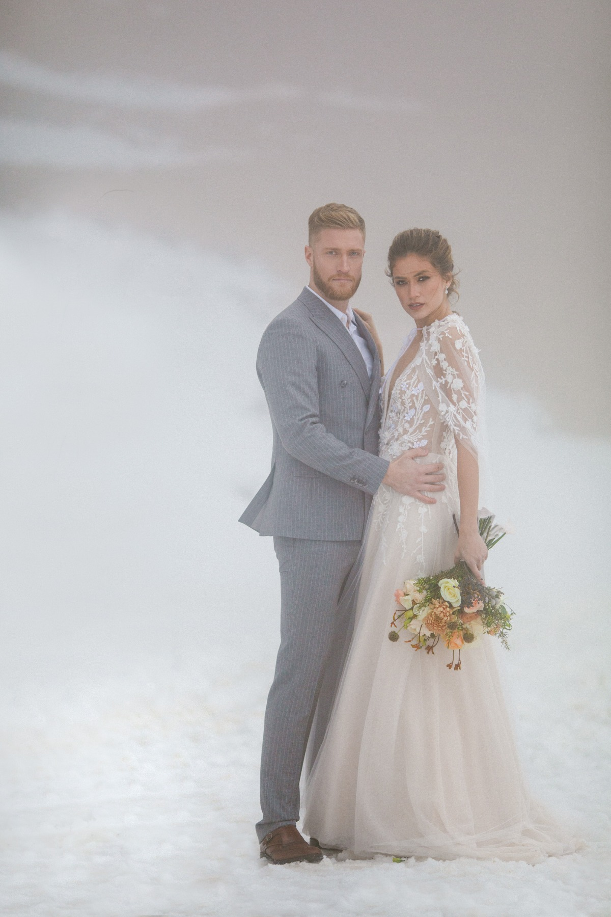 Snowy winter wedding pose ideas for bride and groom outside