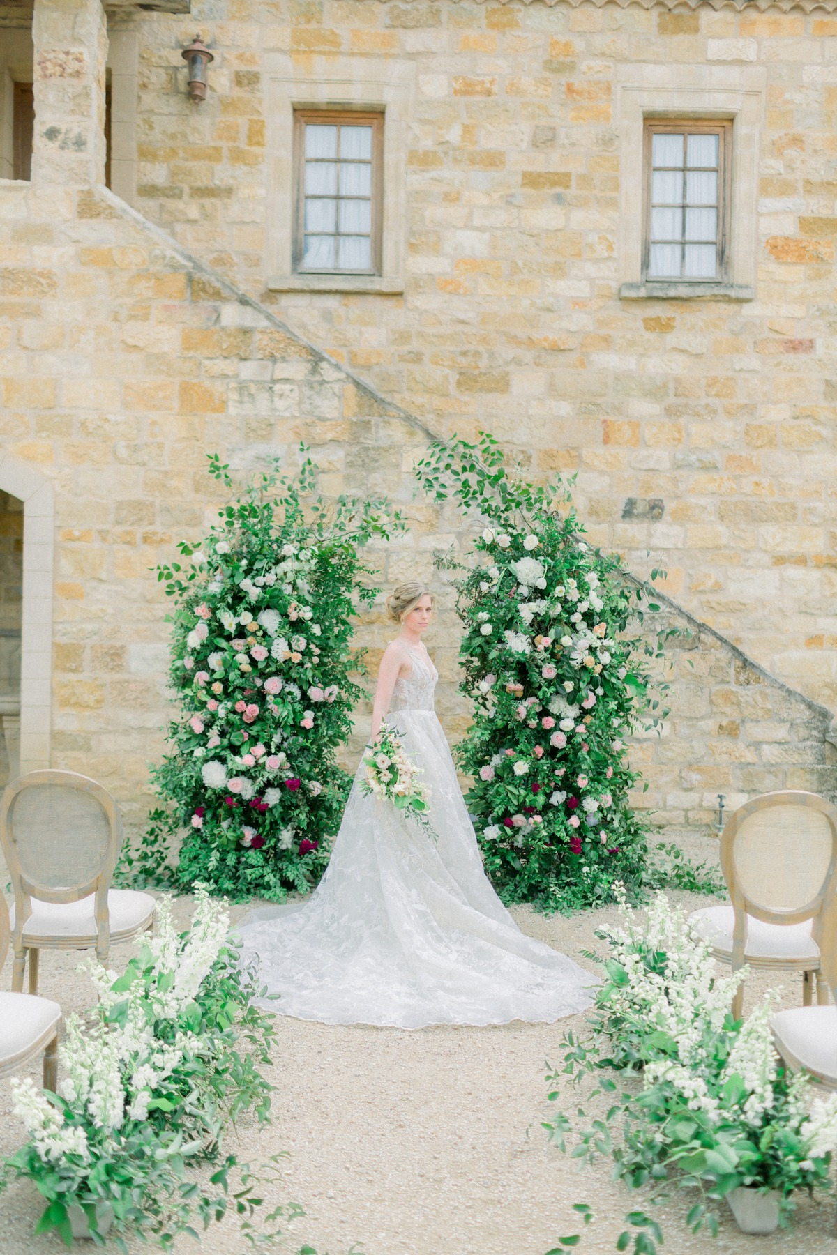 Outdoor rustic wedding ceremony with floral arch