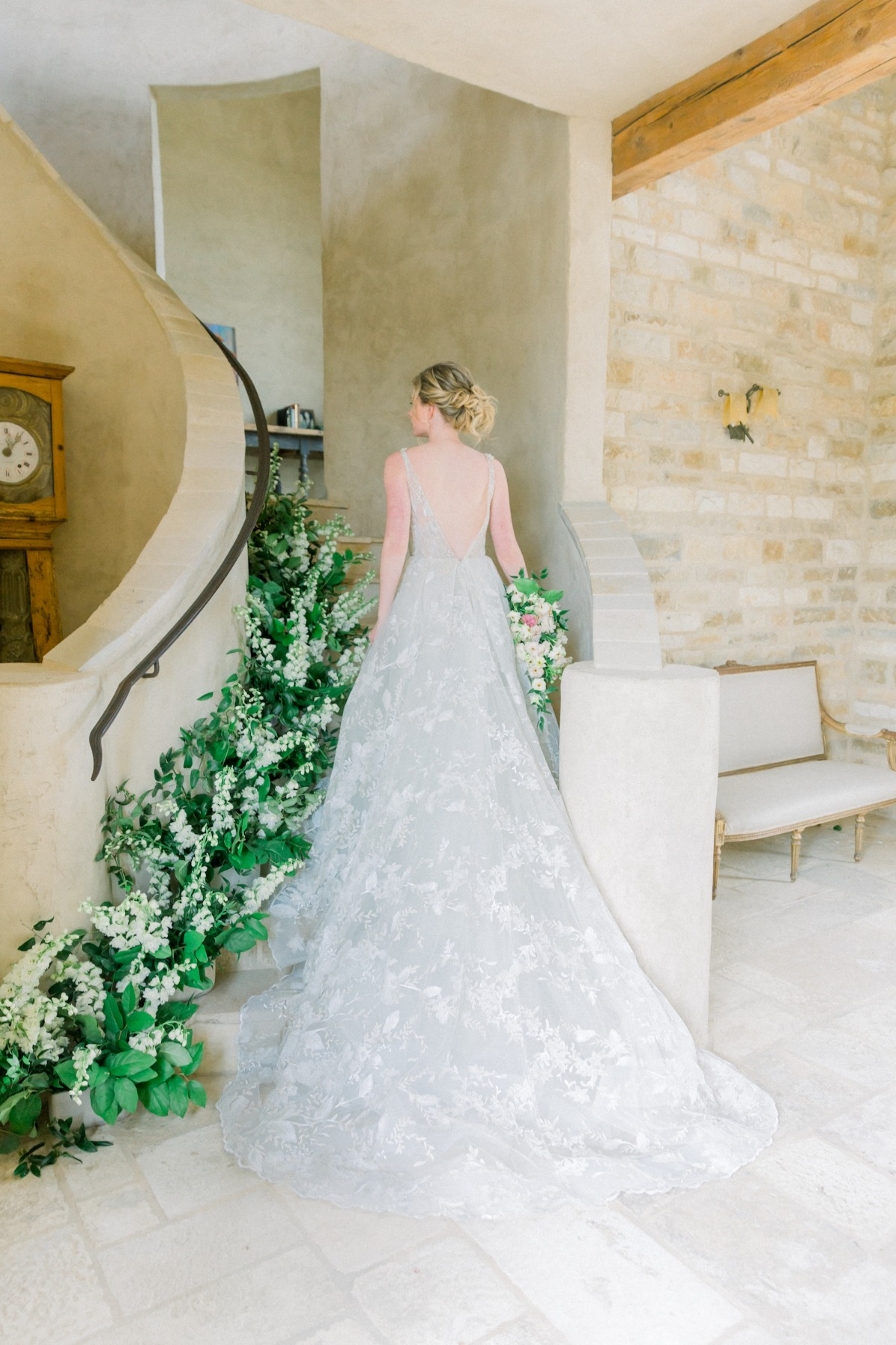 Hailey Paige Bridal wedding gown walking up staircase at Sunstone Villa