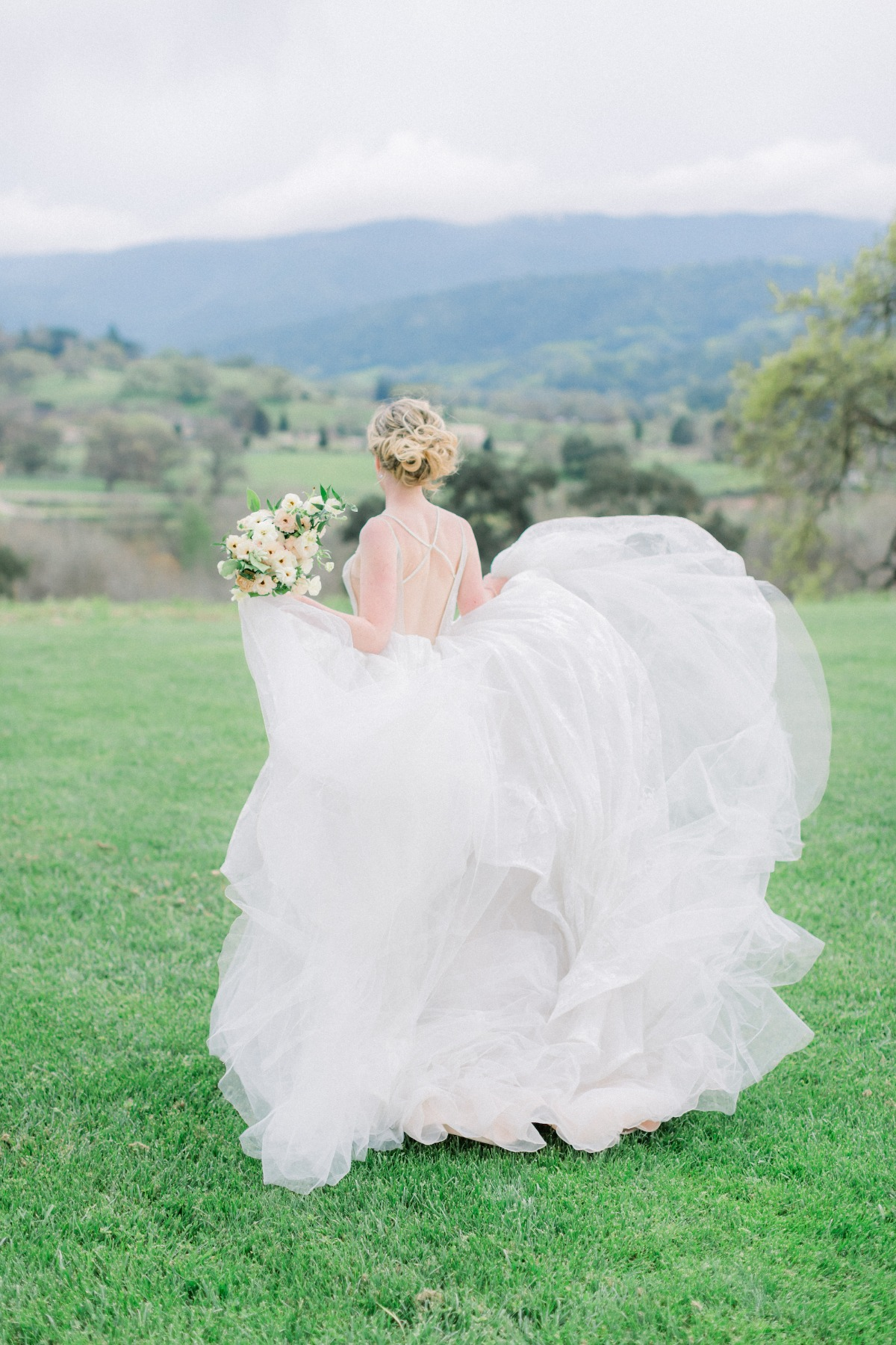 Haley Paige wedding gown with bouquet by Tyler Speier Events