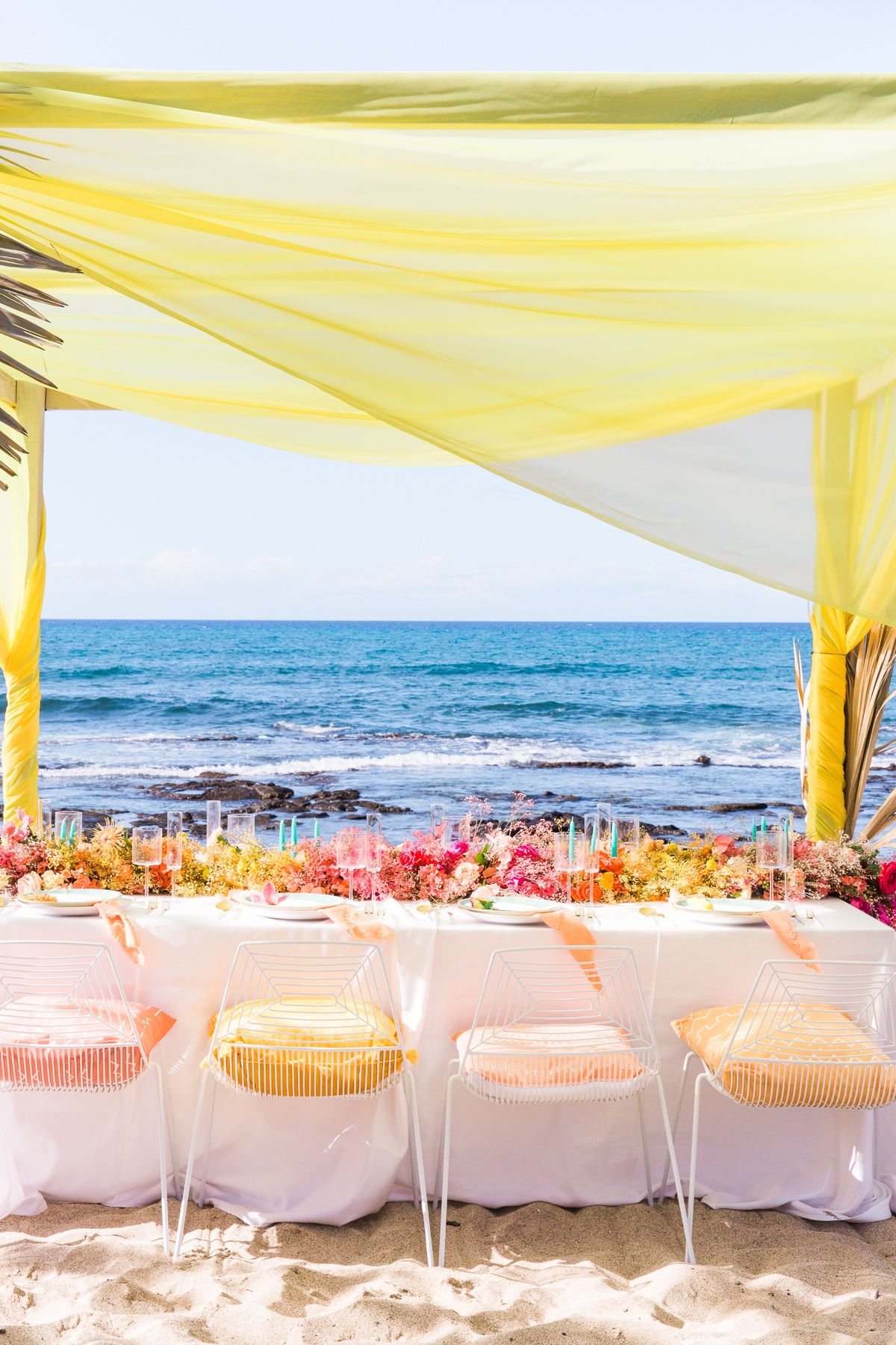 Rainbow wedding reception at the beach