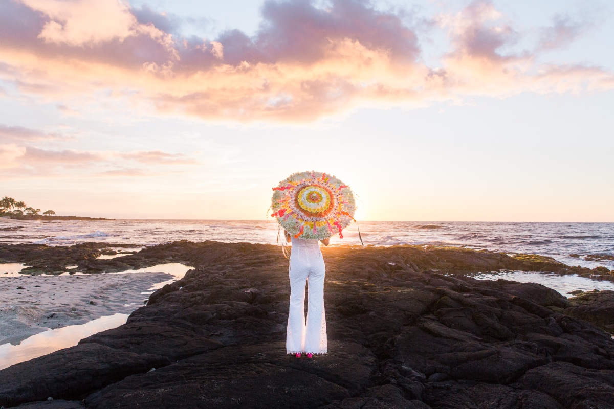 bride standing on lava at sunset in Hawaii
