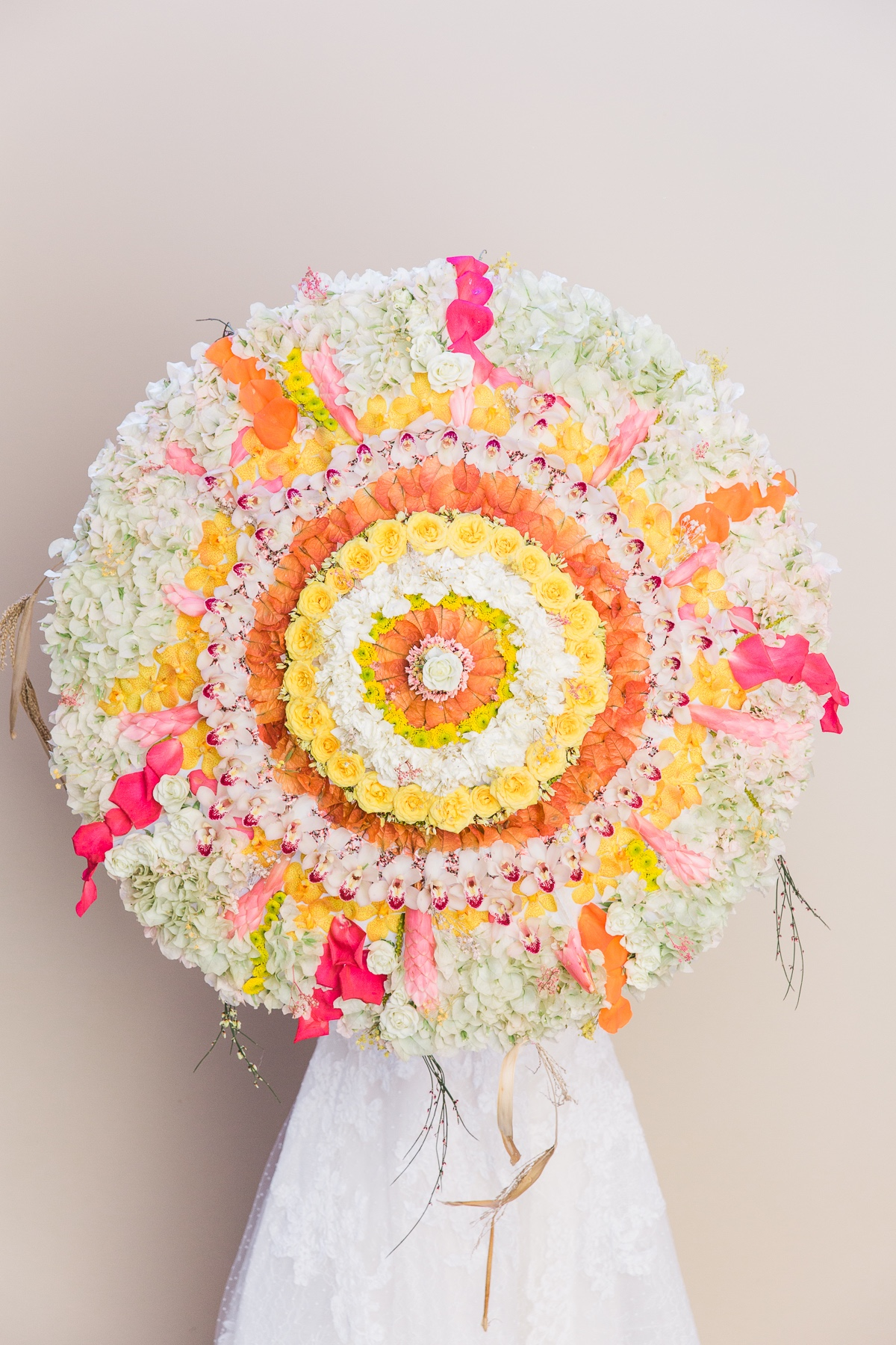 umbrella that is decorated with florals by Grace Flowers