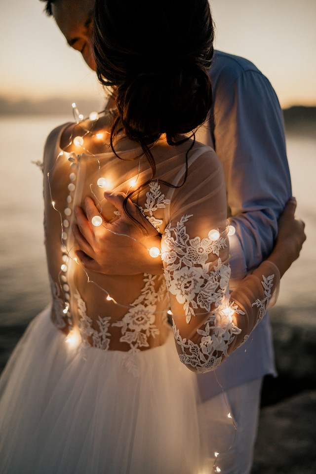 twinkle lights wrapped around bride and groom