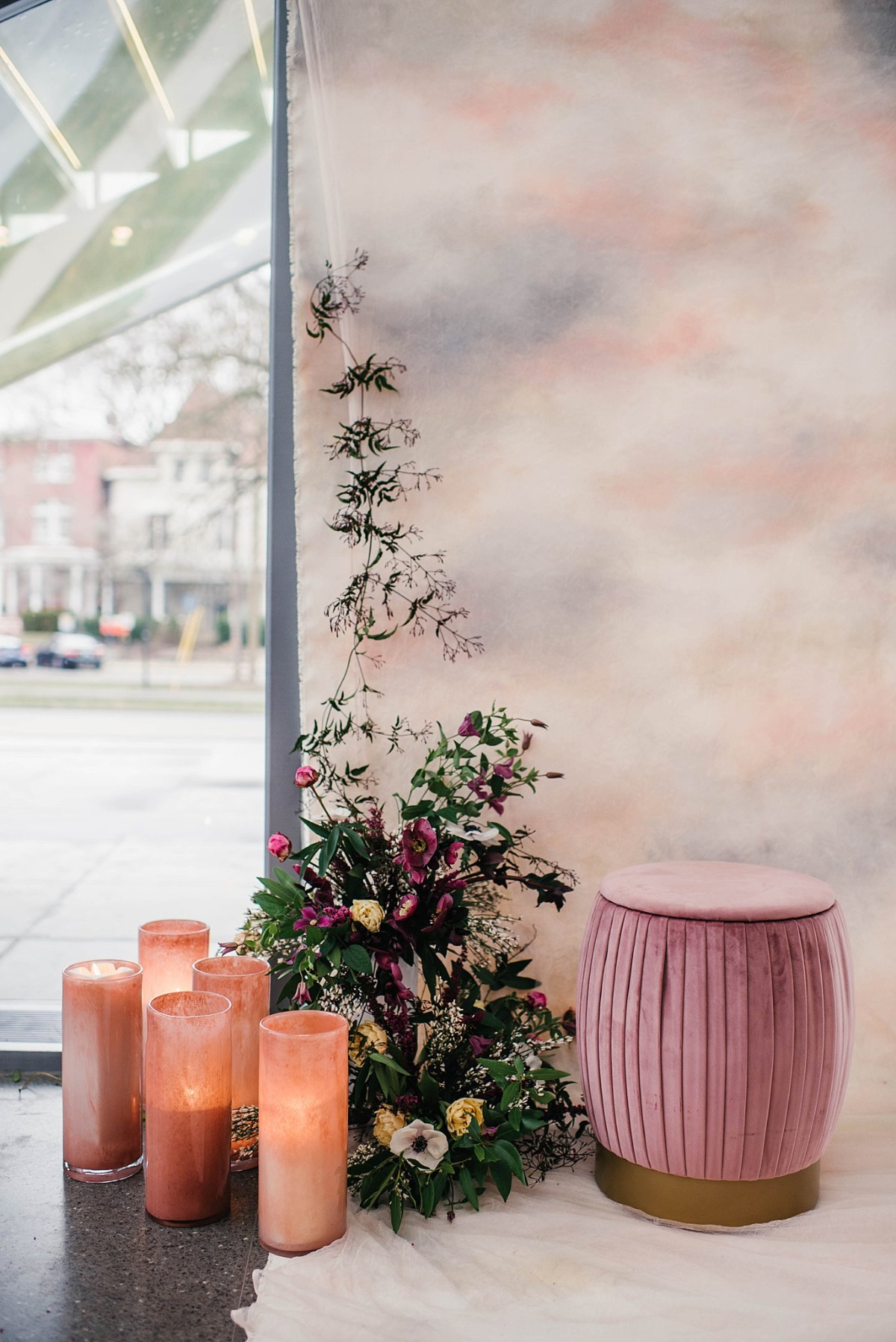 tie-dyed canvas with pops of pink makes for a retro wedding backdrop