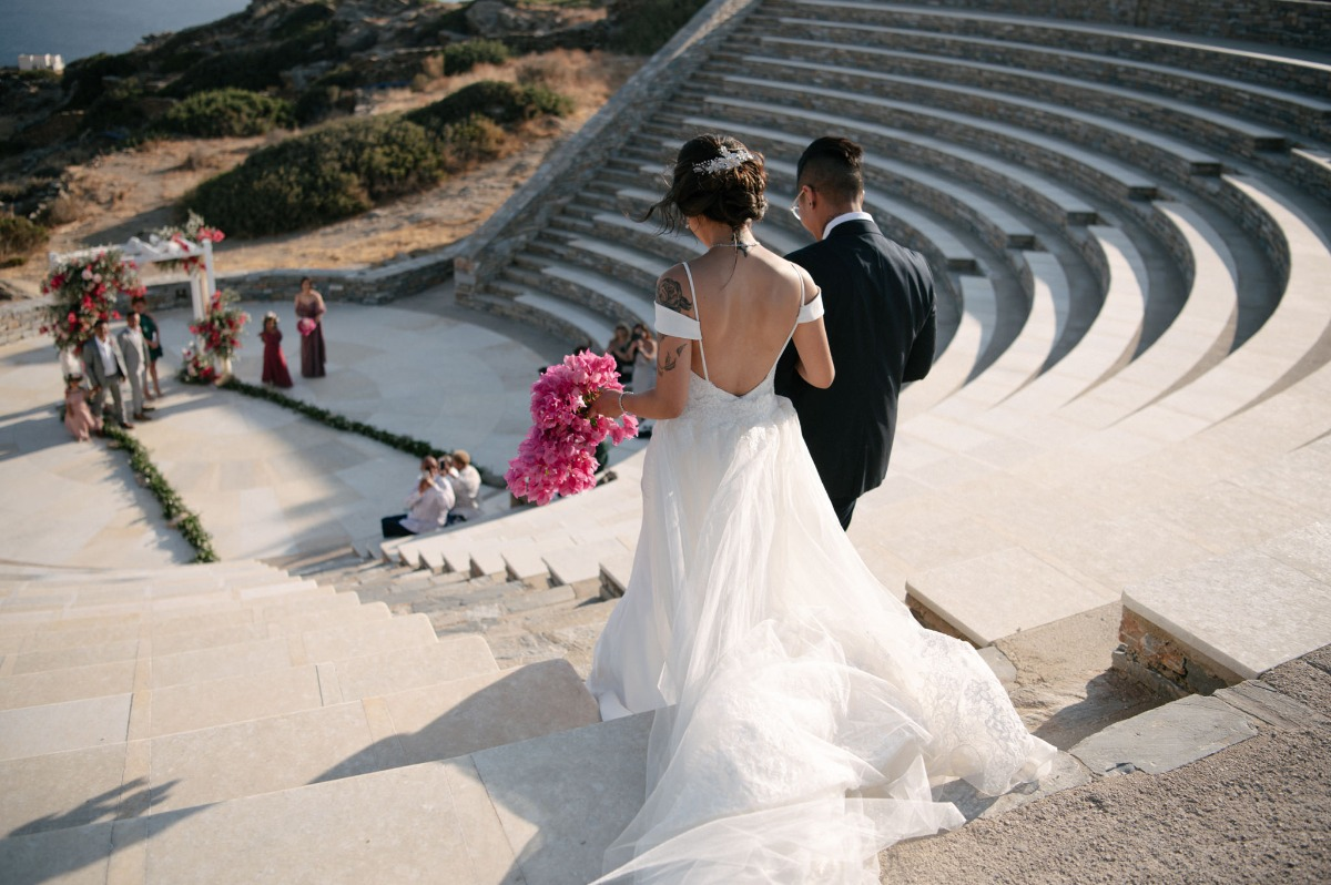 bride walking down the aisle at Greece ceremony site, theater of Odysseus Elytis
