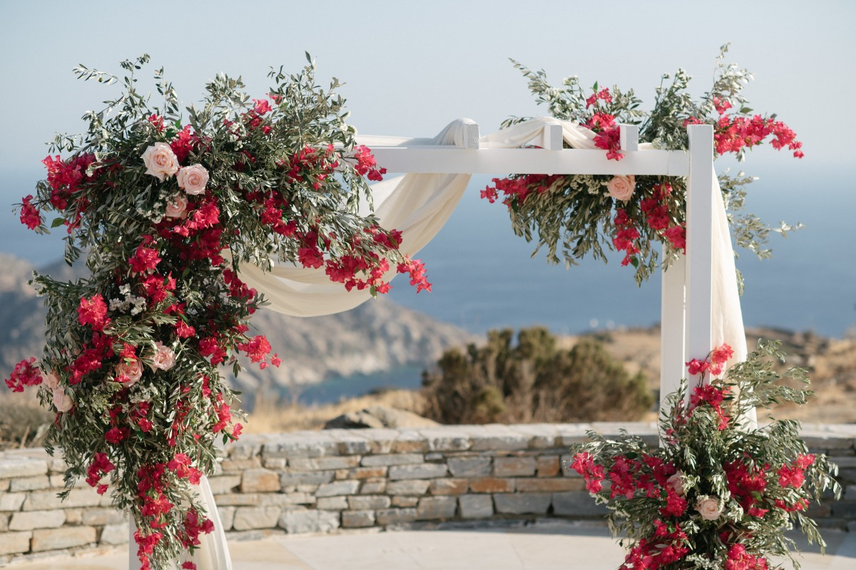 wedding back overflowing with bright pink bougainvillea blooms and garden roses