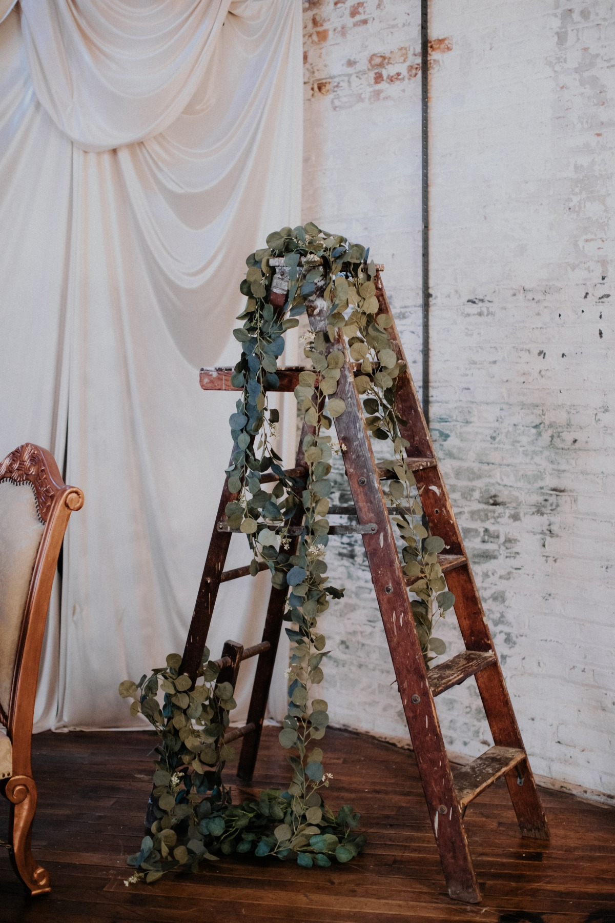 ladder decorated with eucalyptus
