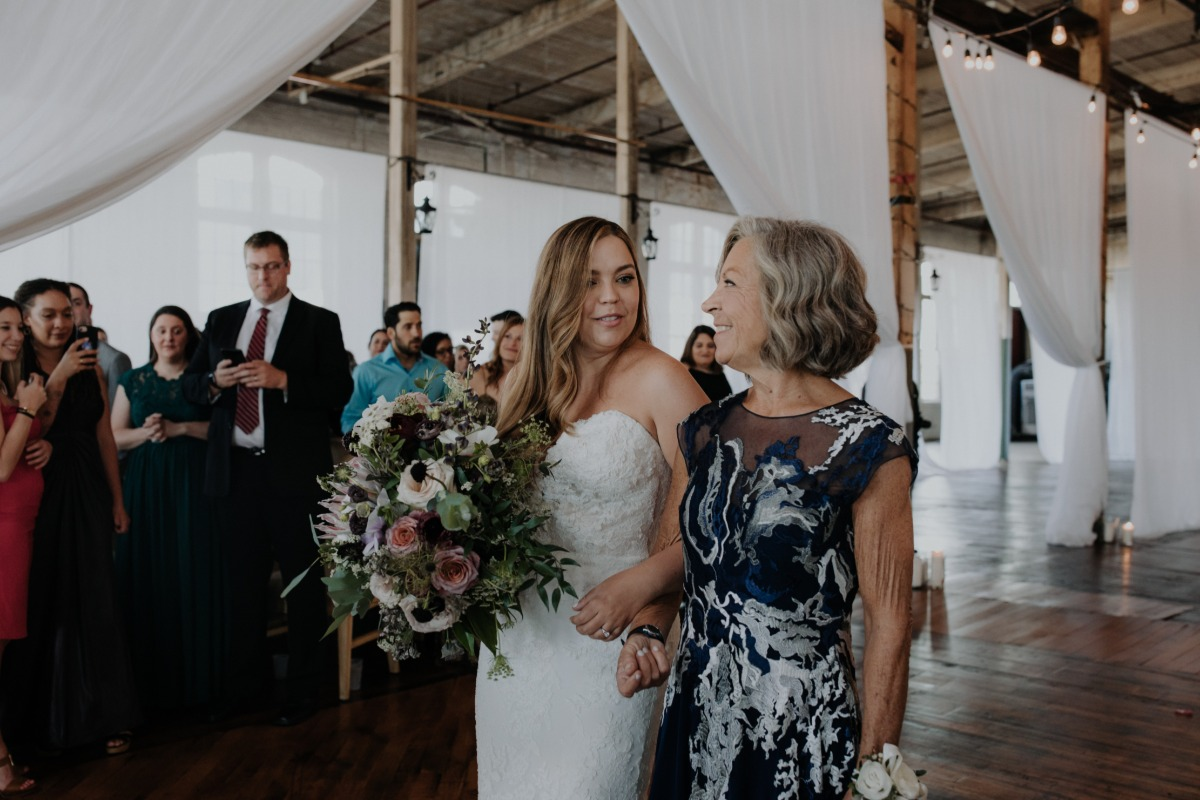 Mom walking daughter down the aisle
