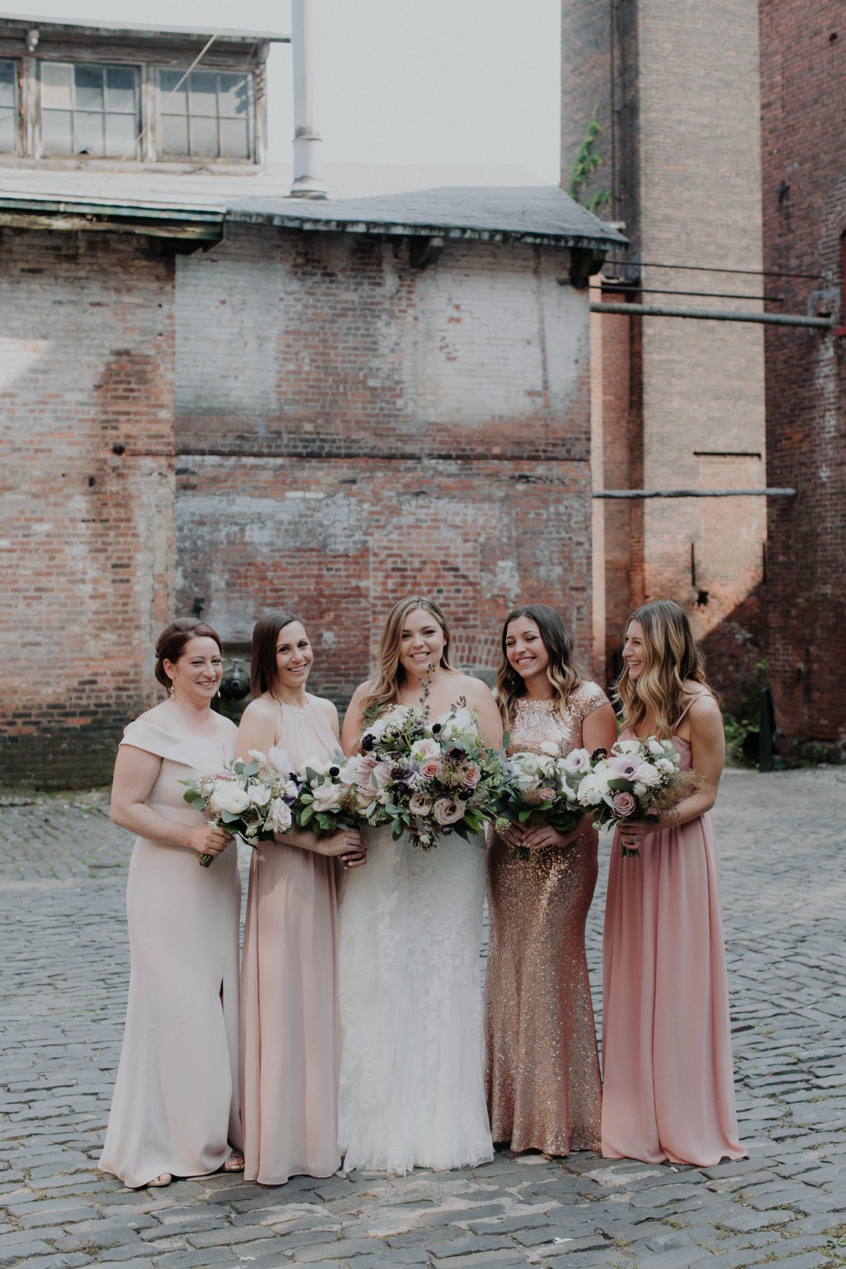 mismatched blush and rose gold sequined bridesmaid dresses