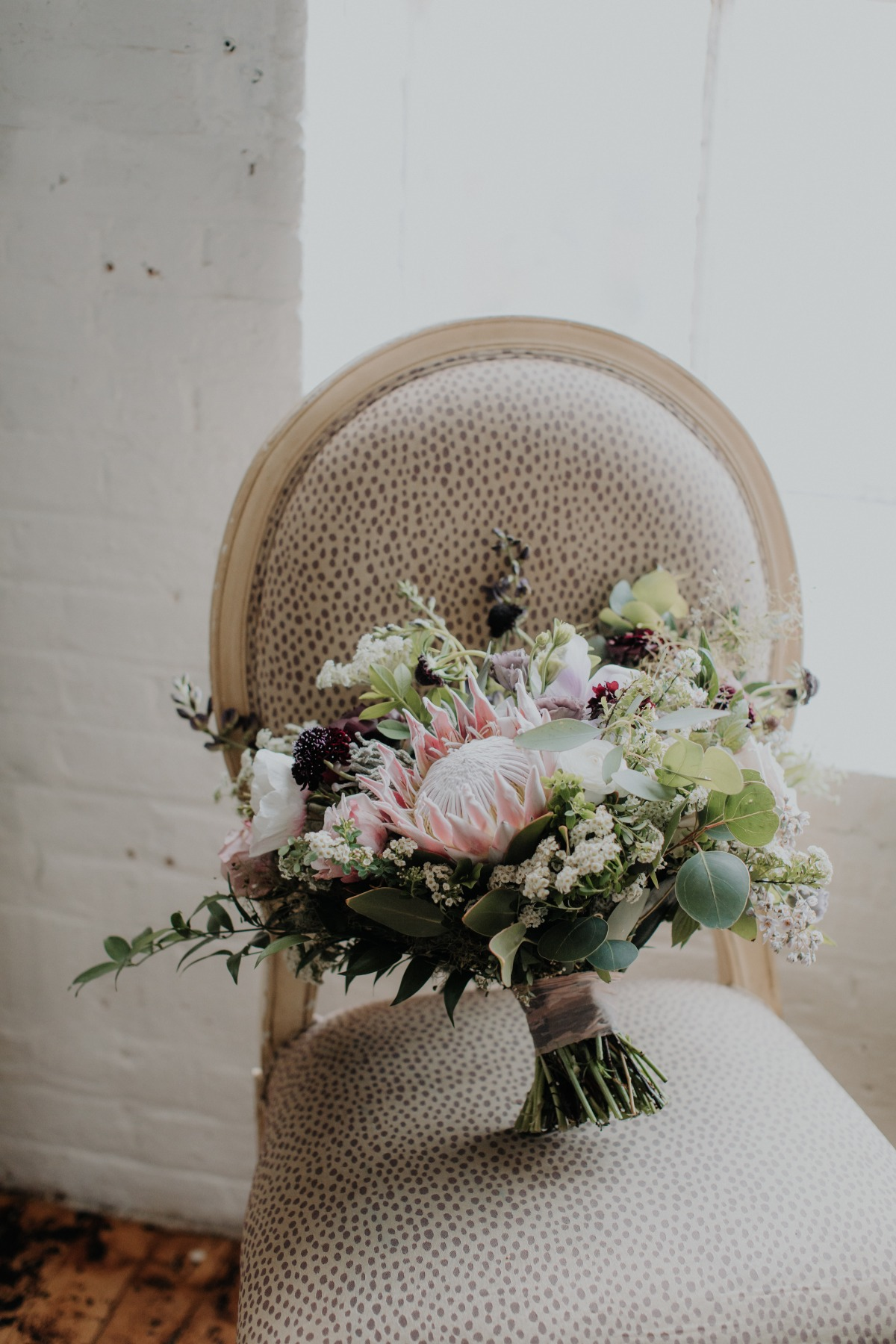 Protea and rose wedding bouquet designed by New Hampshire wedding florist, Apotheca Flowers.