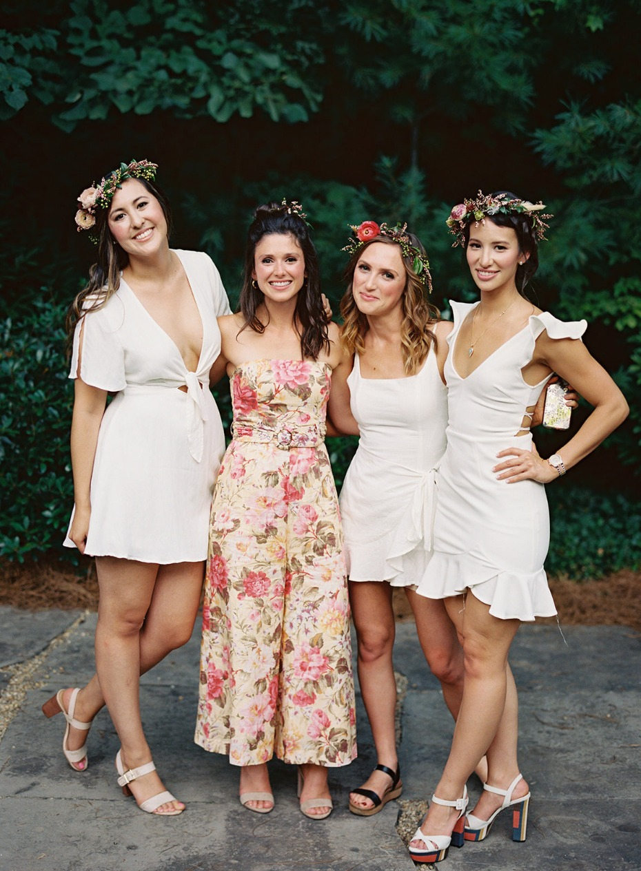 White linen welcome dinner with floral crowns