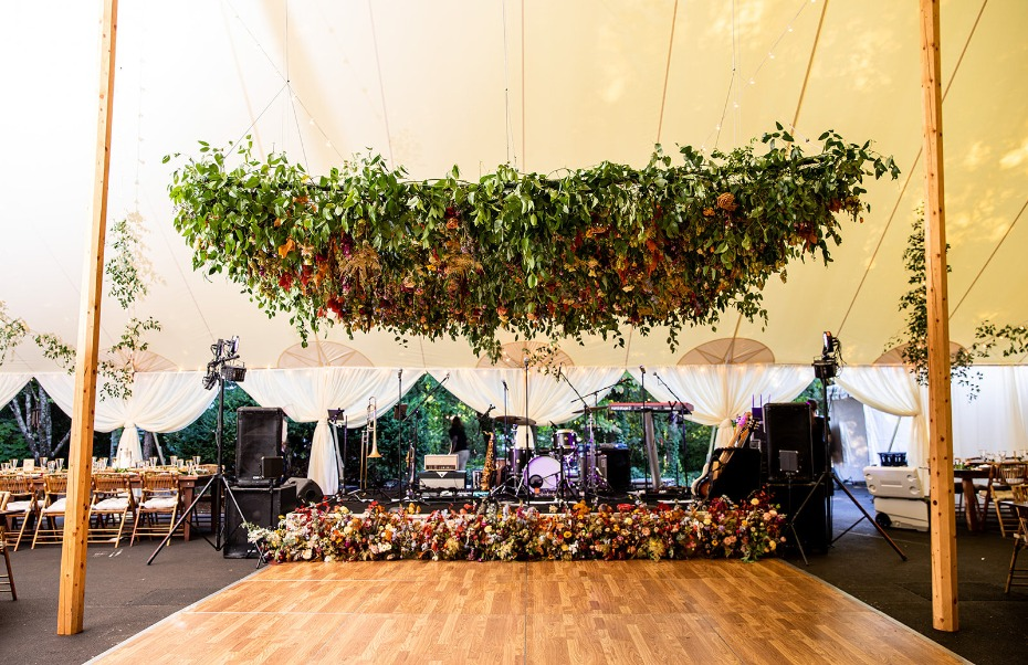 An oversized square hanging flower installation