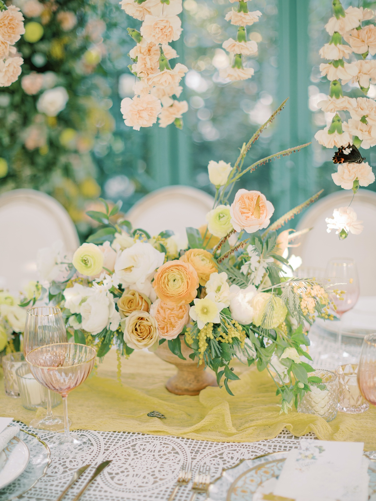 peach, yellow and green wedding centerpiece