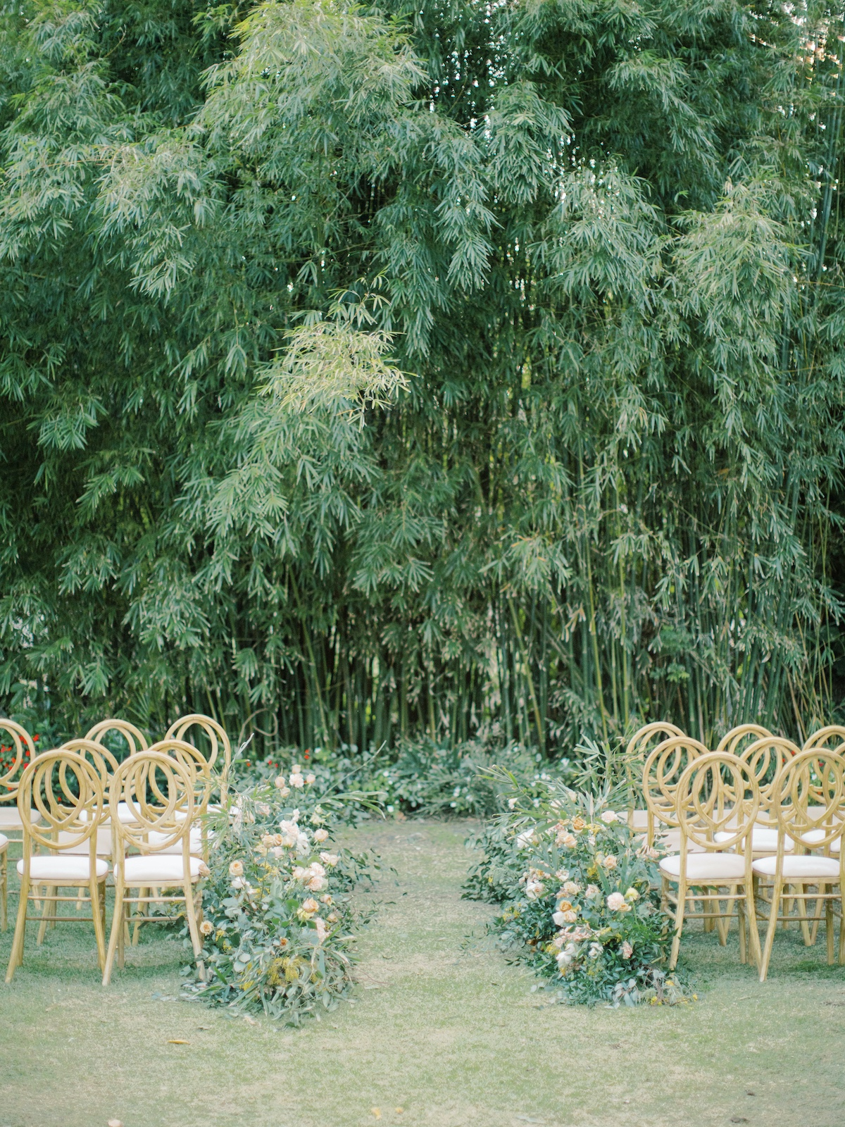 wedding ceremony in front of a forest of bamboo