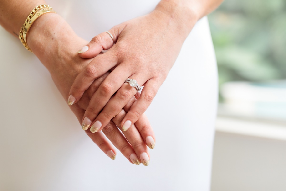 Cartier love bracelet paired gold and nude wedding nail ideas