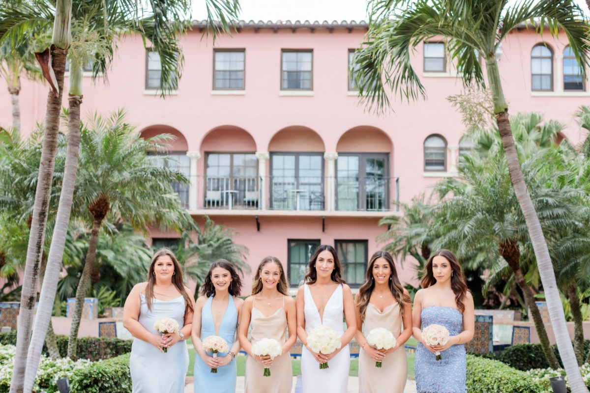 mismatched baby blue and nude bridesmaid dresses