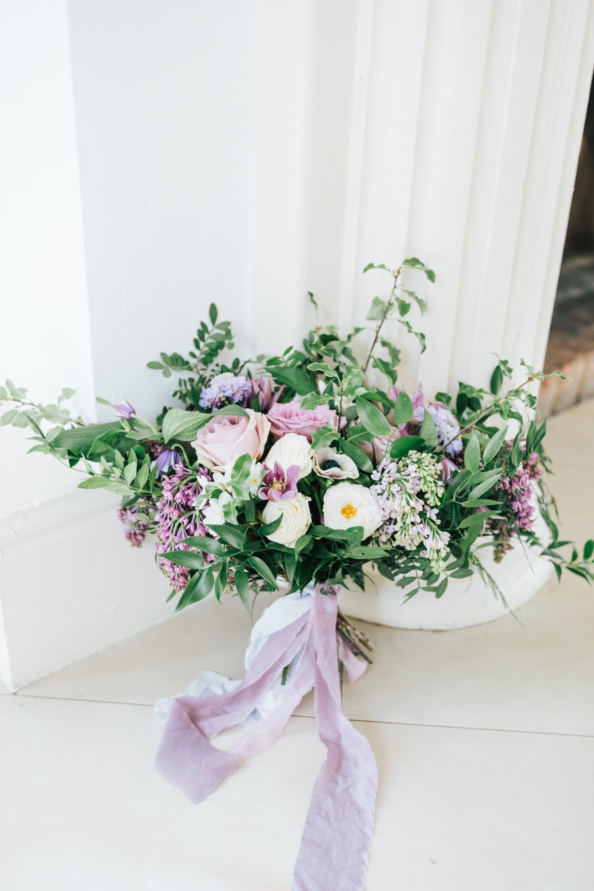 purple and white wedding bouquet with ribbion from The Botanical Dyer