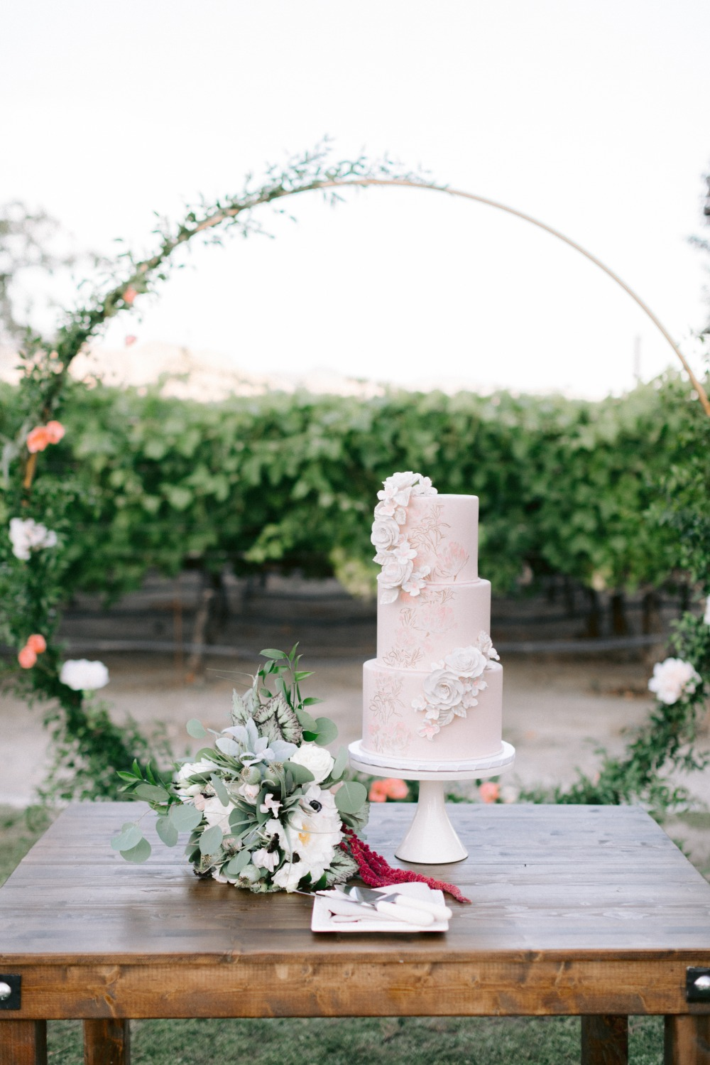 floral hoop with pink wedding cake