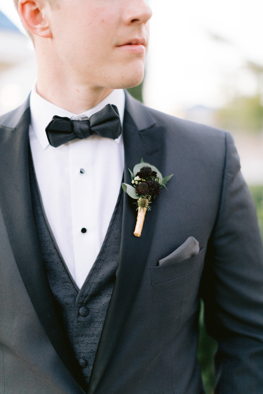 black white tux with black boutonniere