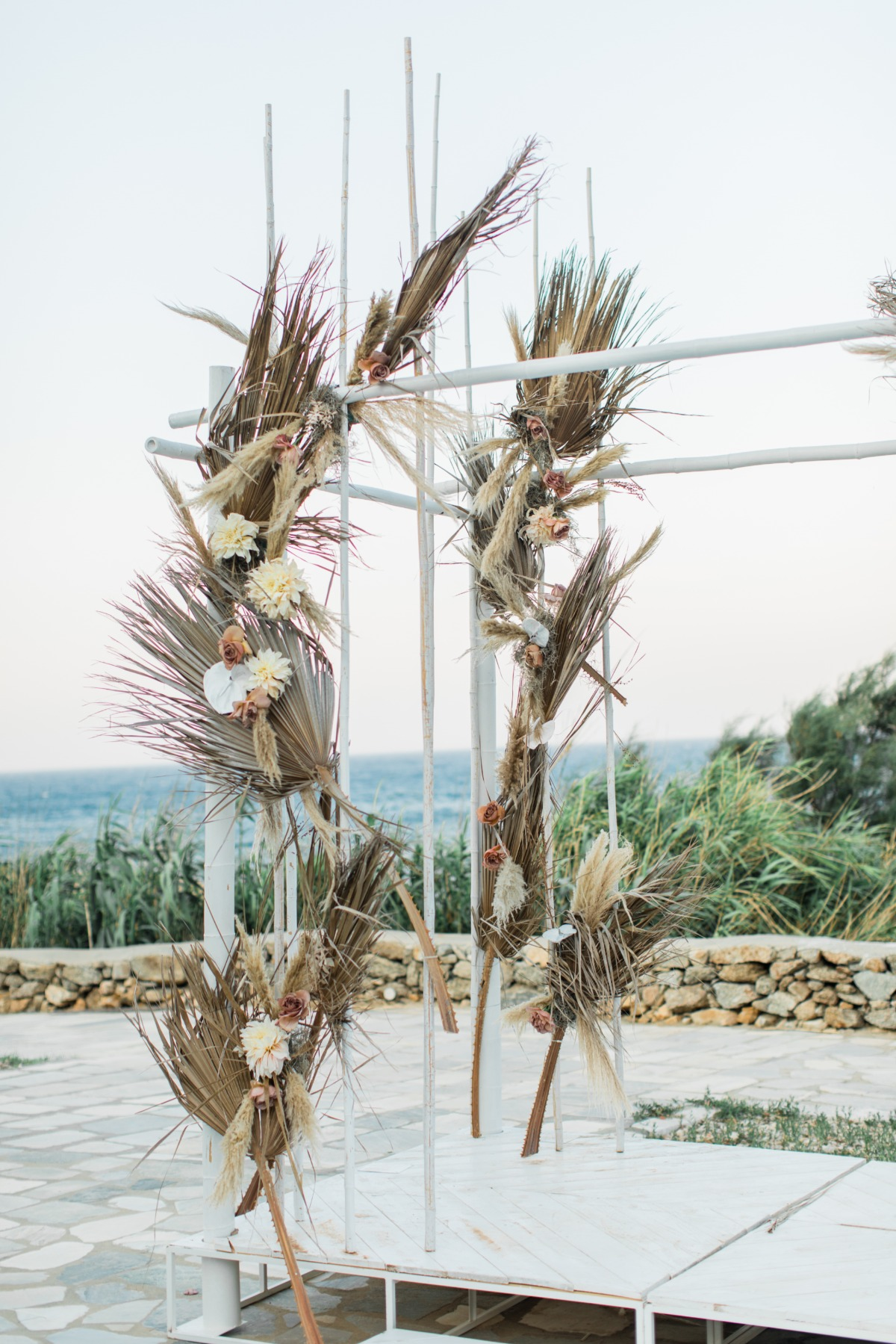 Dried floral backdrop from Greece wedding rentals Ceremonies by Rakor