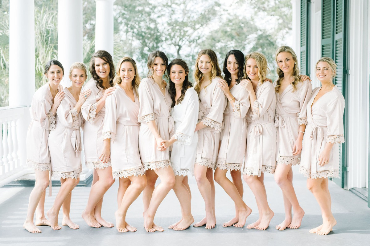 bridesmaids in blush wedding robes with lace edges