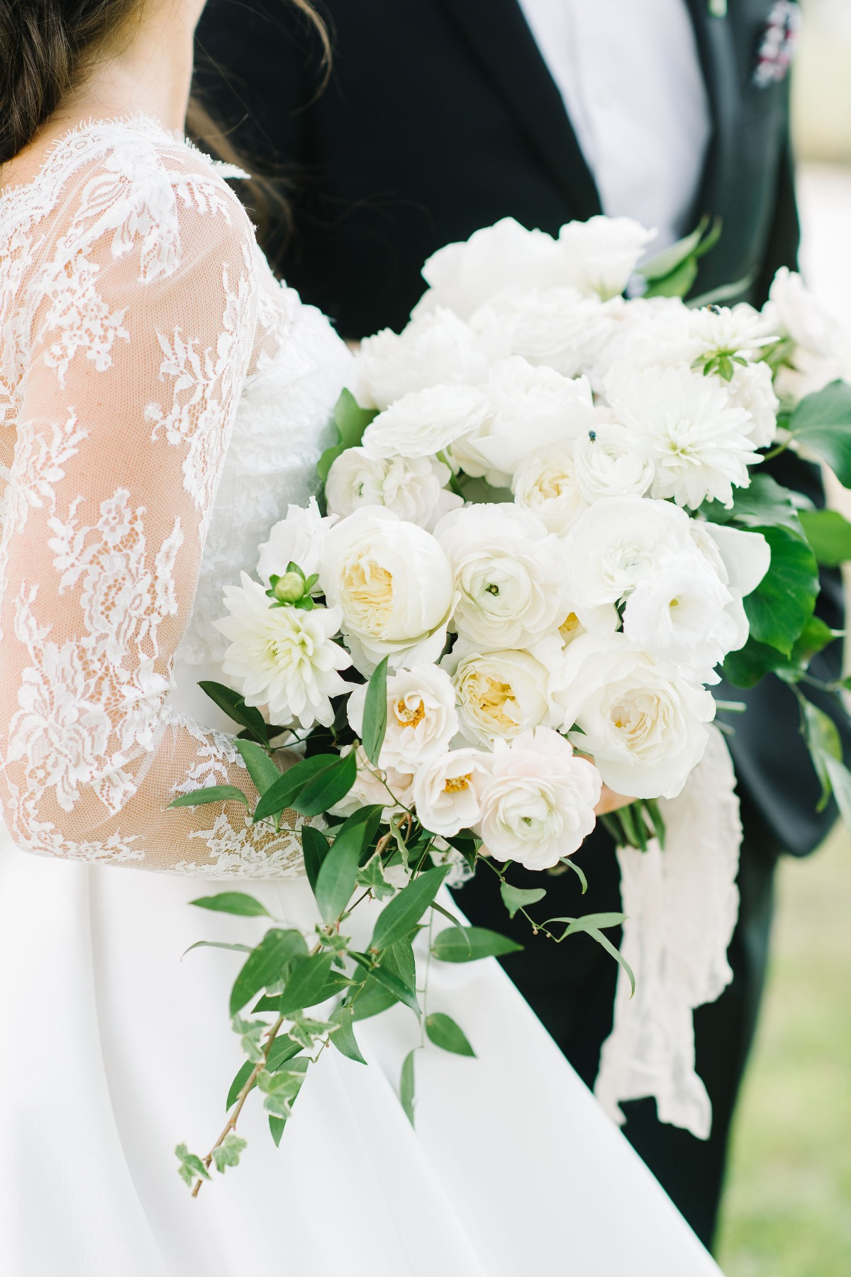all white wedding bouquet with a sprinkle of greenery